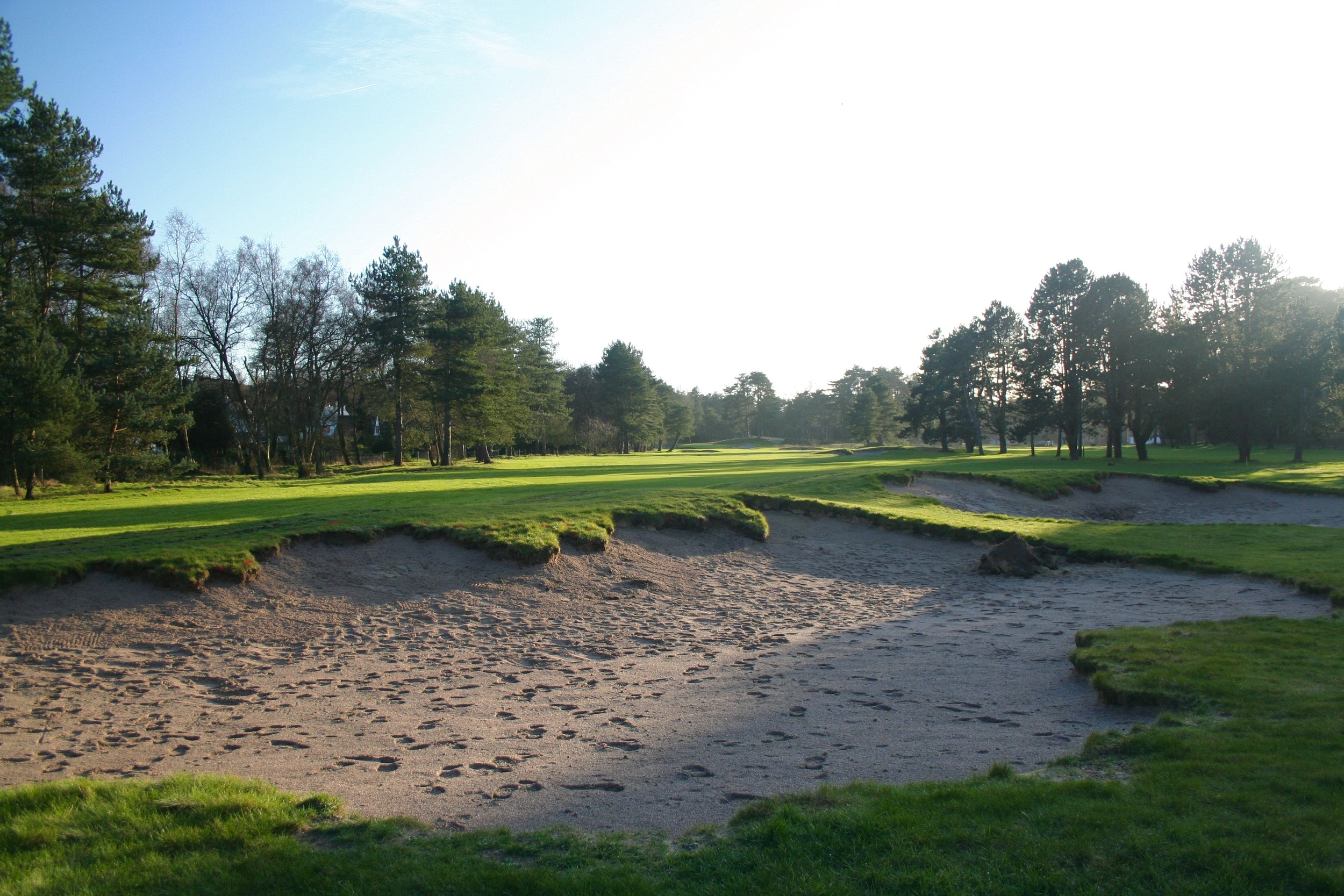 A combination of excavator and shovel work was used to make these once smooth revetted edges appear more like the original edge style used by Tom Simpson.