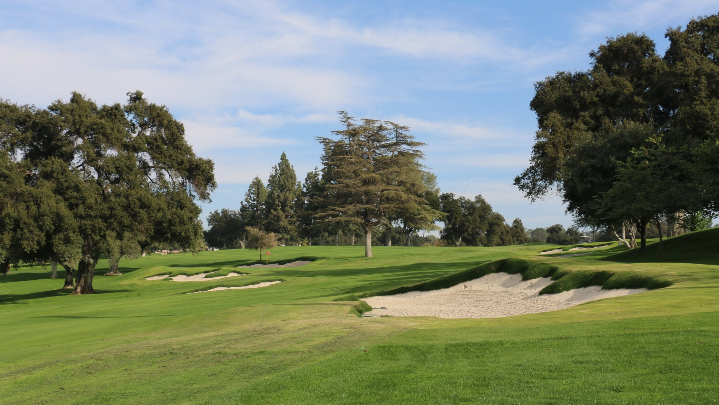 The ideal angle into the 1st green at Redlands is from over here.  Image courtesy of Todd Eckenrode, Origins Golf Design