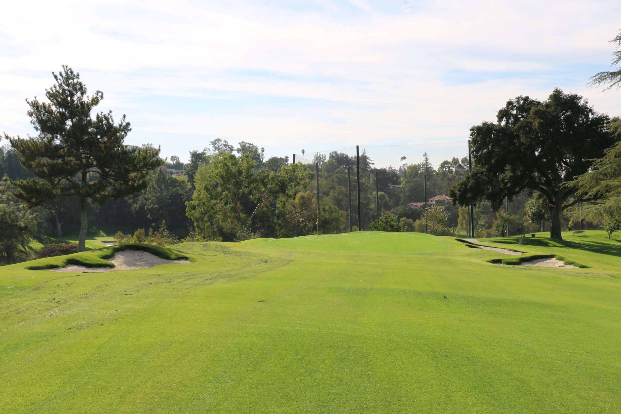 The 4th green was once guarded by trees, but now they are gone with the green surface pushed to the edge and softened to create nerve-wracking left and back hole locations. The two short bunkers left and right are new additions. Image courtesy of Todd Eckenrode, Origins Golf Design.