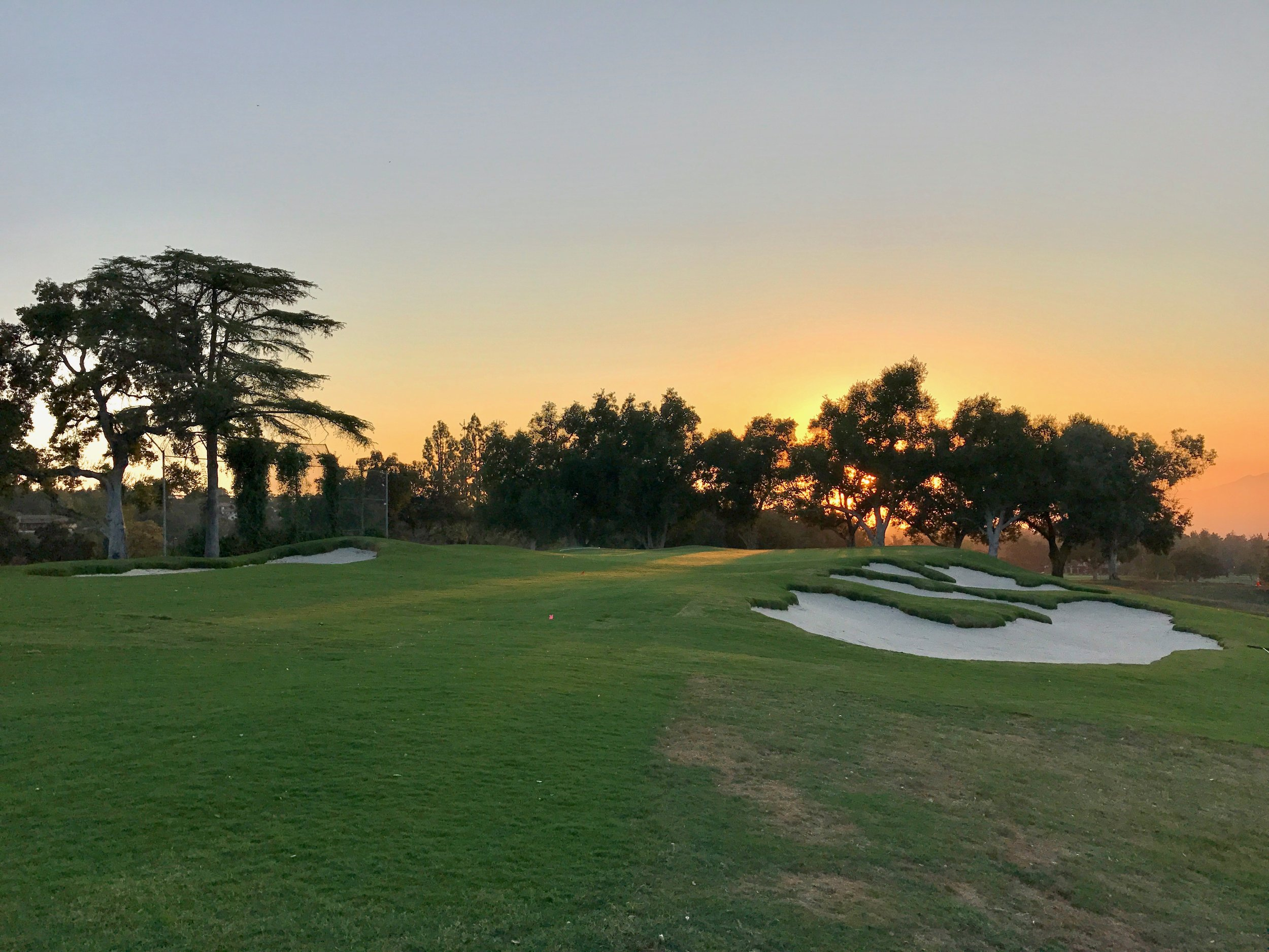 A view of the bunkers and approach highlighting the left to right angle angle of the opening to the green and the slopes that have been built up to help balls onto the green.
