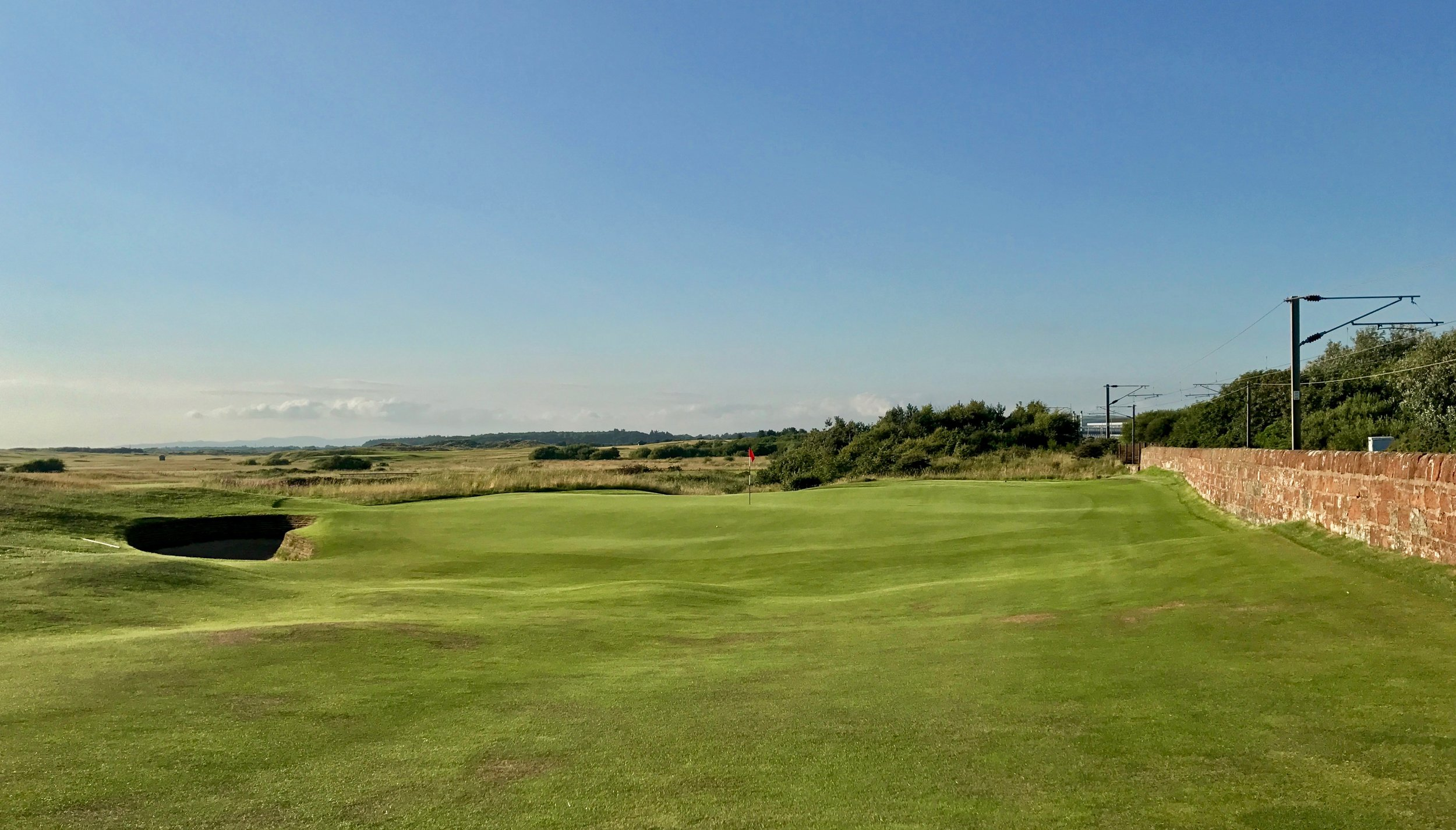 The 1st green at Prestwick is not only cool for how it sits up against the O.B. wall, it is also beautifully contoured.