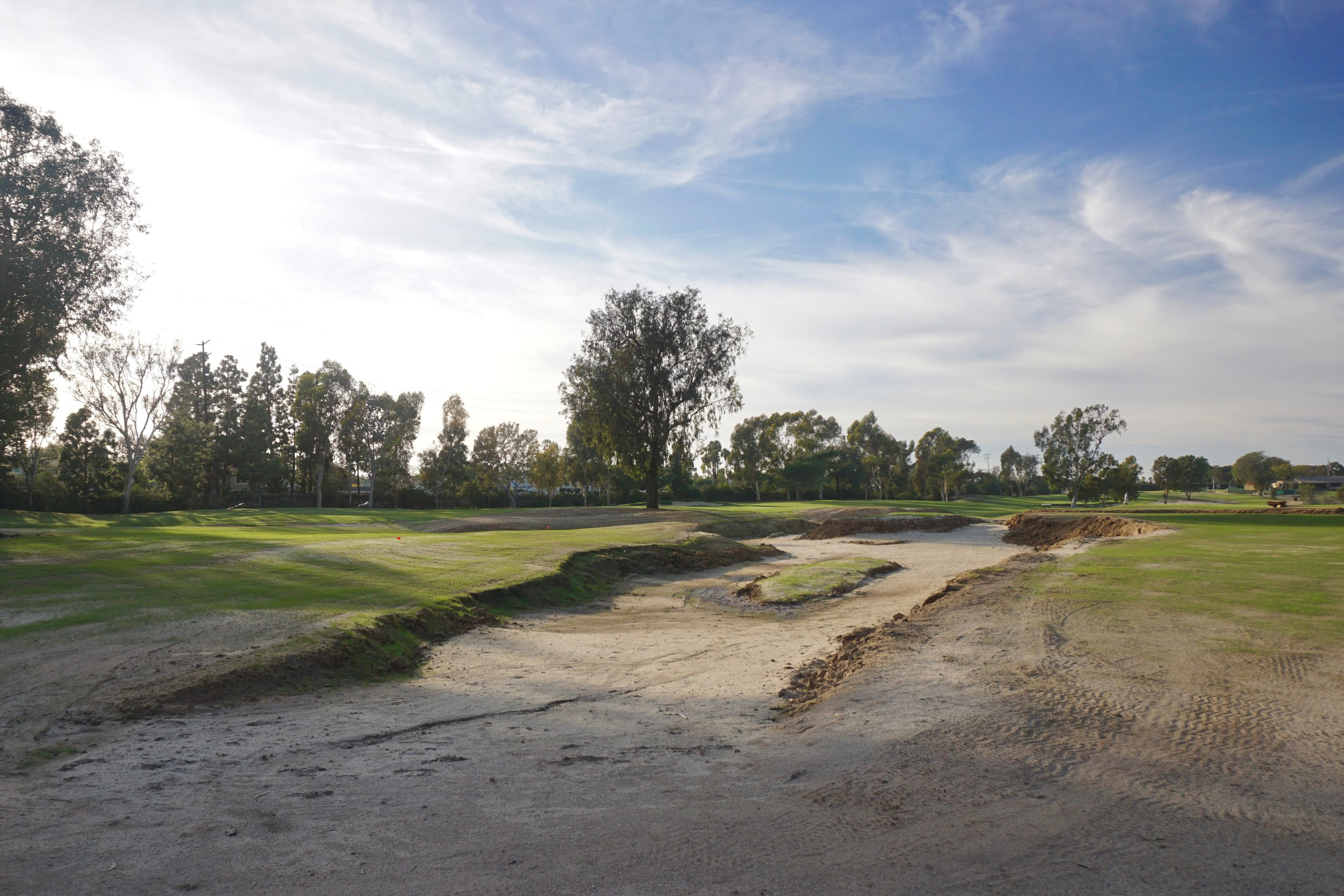 One way to generate fill for other parts of the project was to extend this wash into an out of play area between holes 2, 7, and 8.