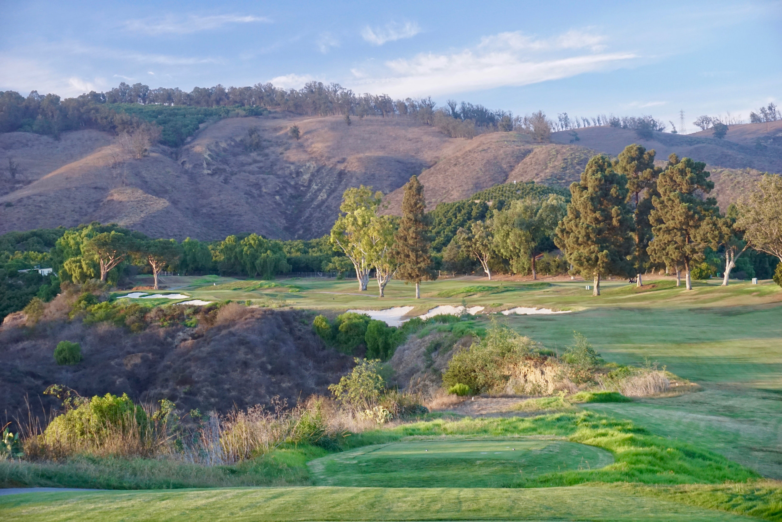 The dramatic canyon hole at Saticoy, No. 14. Here we reworked the left greenside bunker, flipped the back bunker short and left, filled in the right greenside bunker and replaced it with short grass, and added the giant canyon bunker feature at the corner of the dogleg.