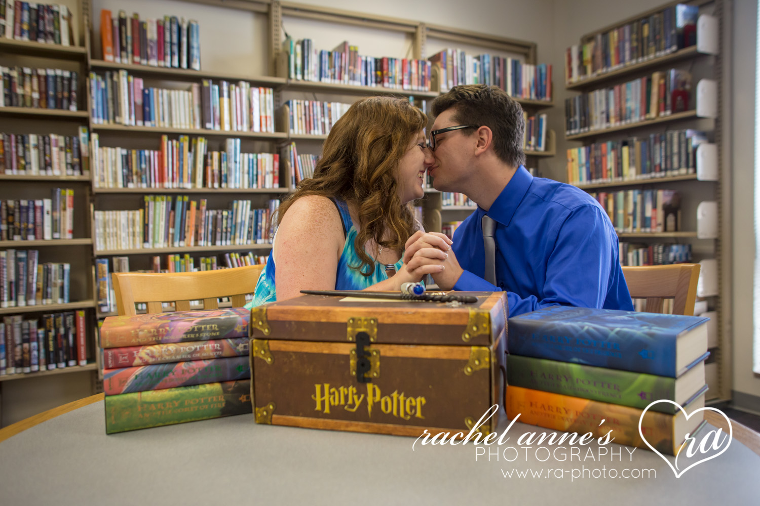 What does a rainy day during an engagement shoot lead to? The cutest pictures in a library & local diner! ;)