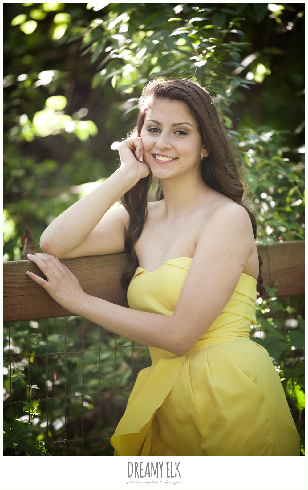 evan high school senior yellow dress leaning against fence