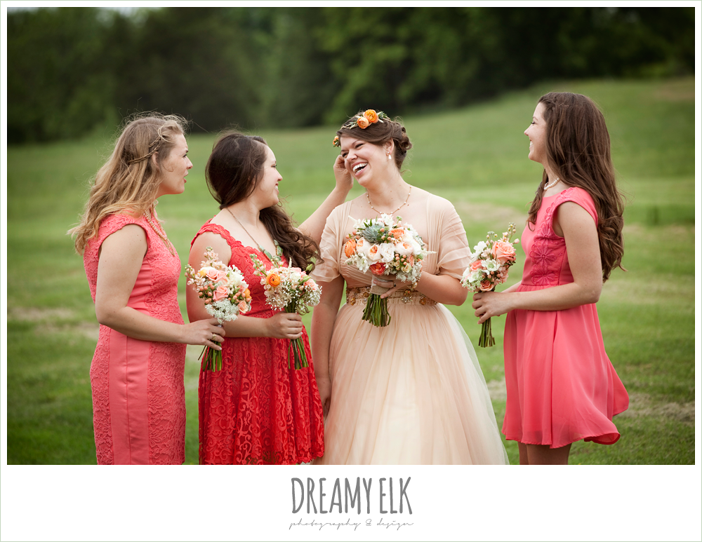 laughing bridesmaids, coral dress, champagne wedding dress