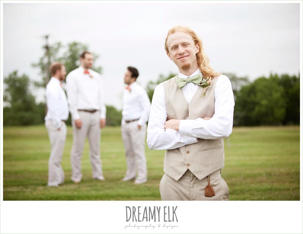 groom in linen vest and green bow tie