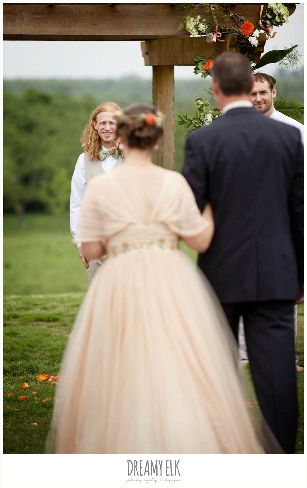 groom watch bride walk down aisle, outdoor wedding