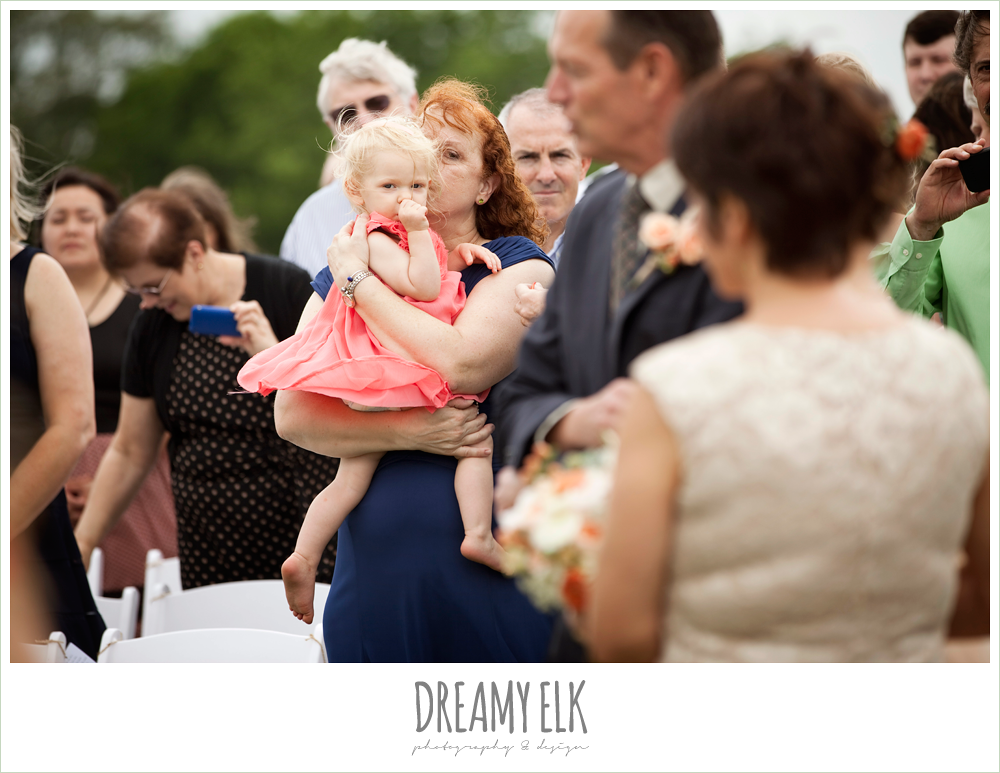 mother of the groom holding baby during wedding