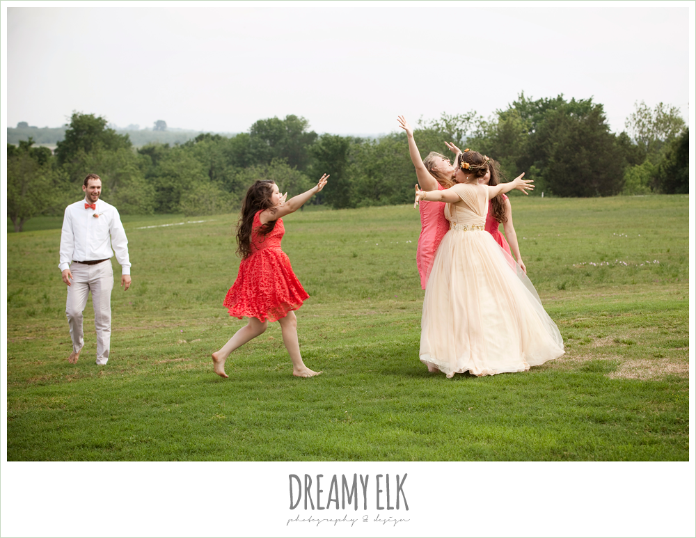 bridal party playing football, girls chest bumping