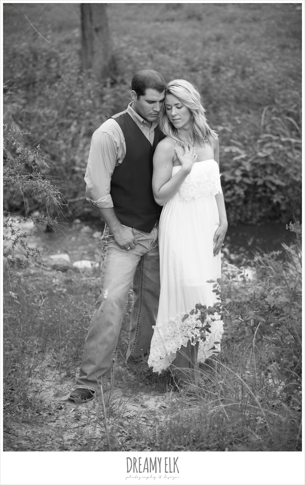 romantic outdoor engagement photo, jeans and vest, white dress