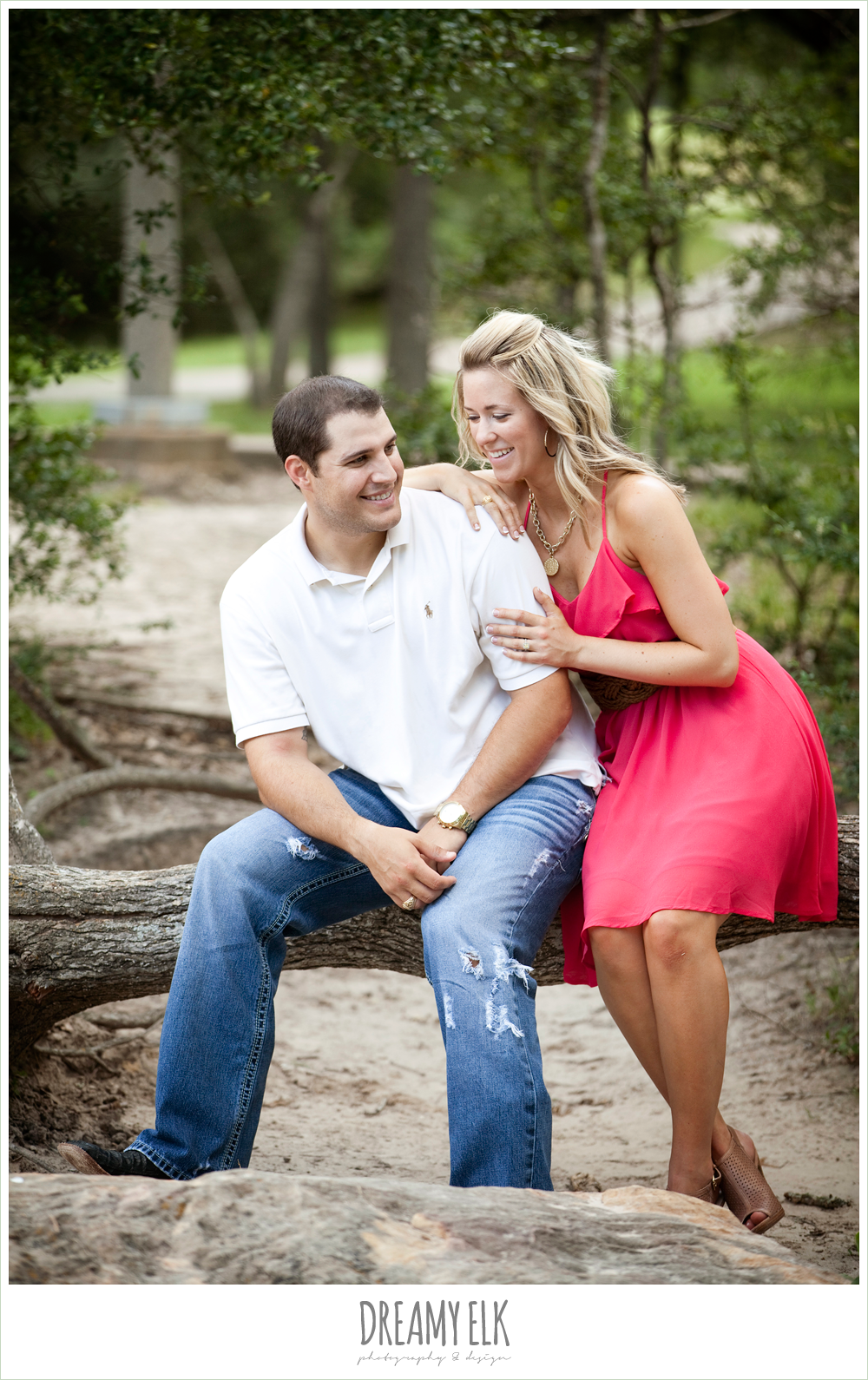 couple sitting on a log, cute outdoor engagement photo