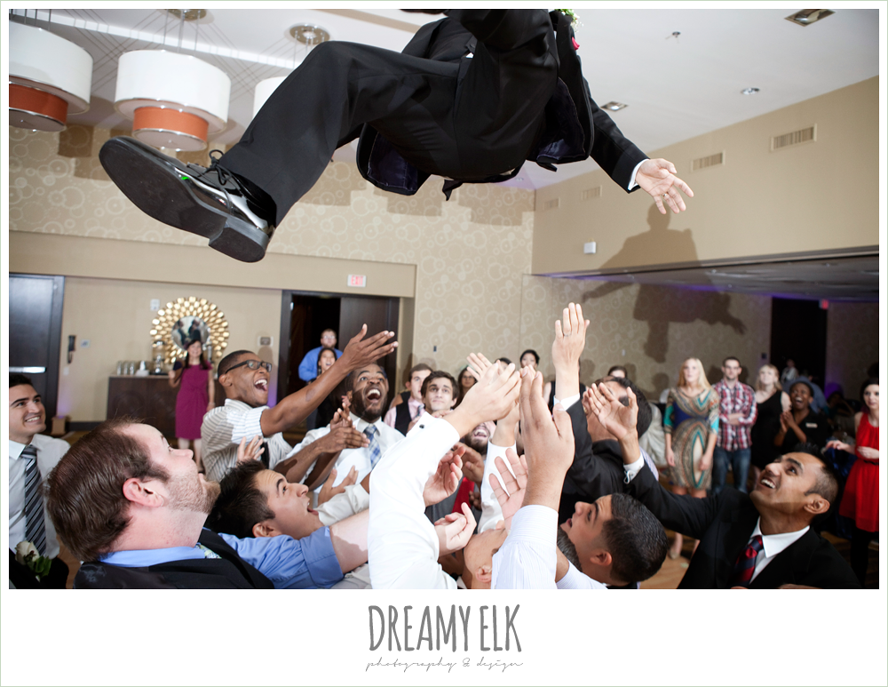 throwing the groom in the air, hilton hotel ballroom, university of houston, dreamy elk photography and design