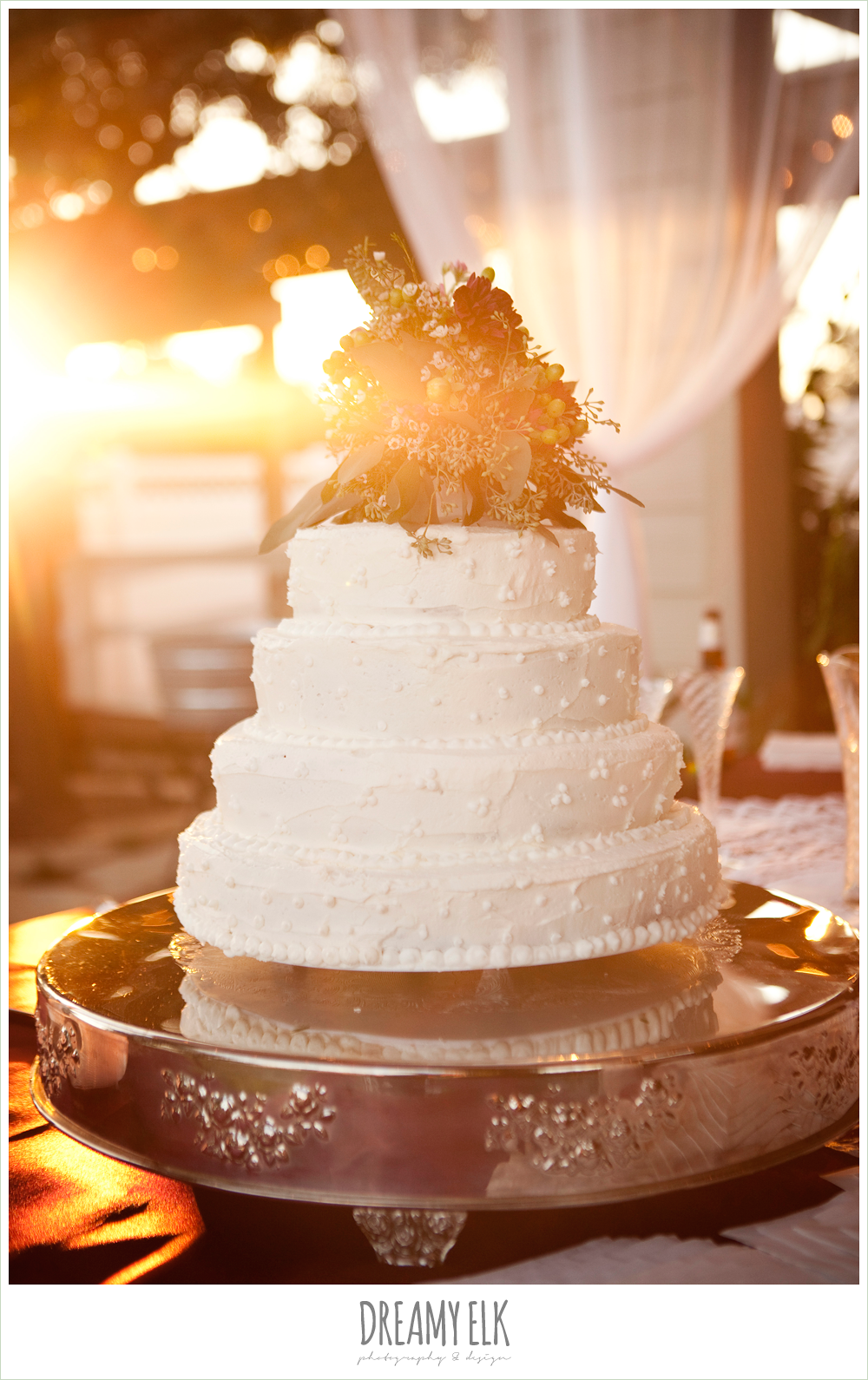 four tiered wedding cake with flowers on top, october wedding, inn at quarry ridge, dreamy elk photography and design