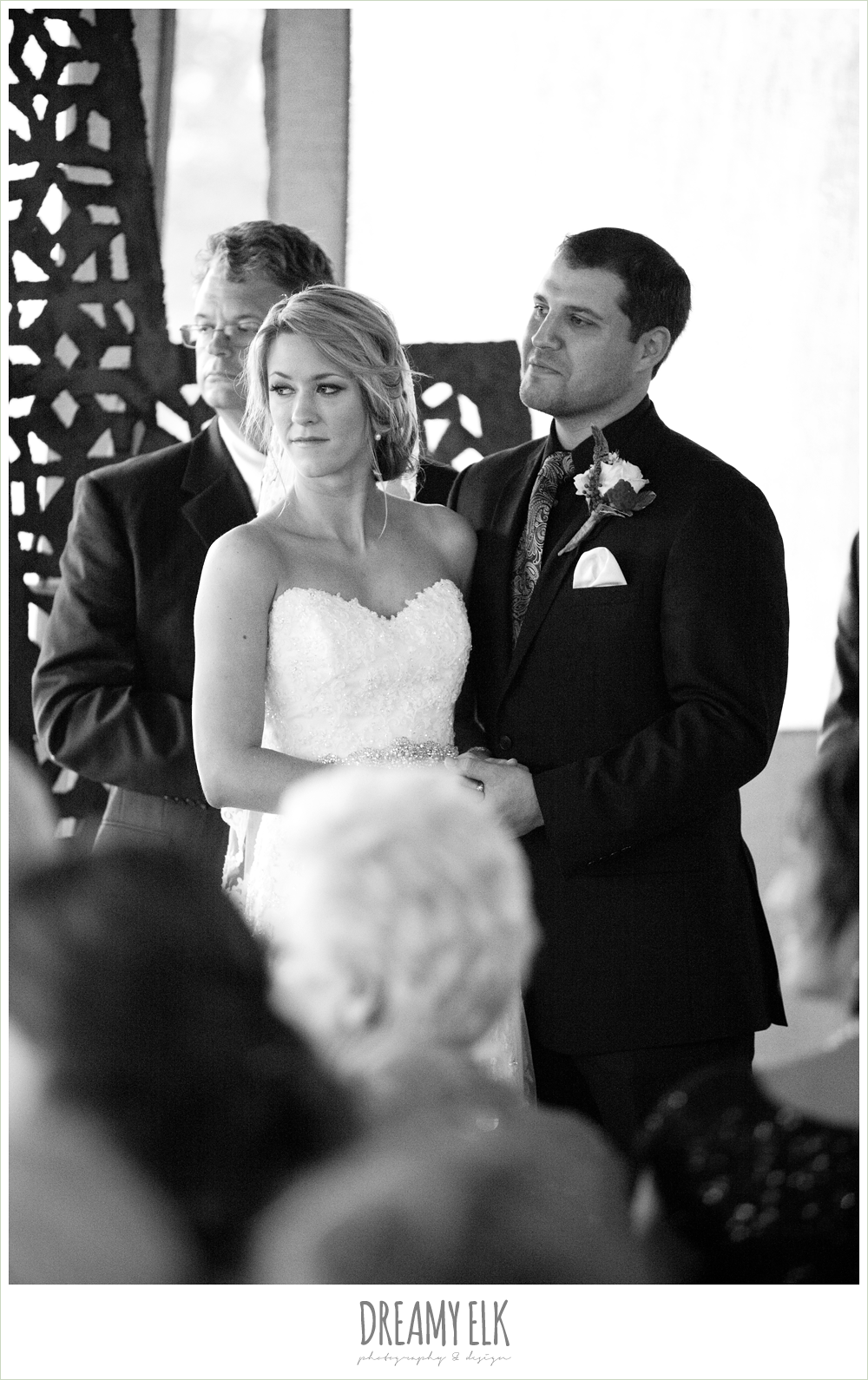bride and groom during the ceremony, rainy fall wedding, rock lake ranch, dreamy elk photography and design