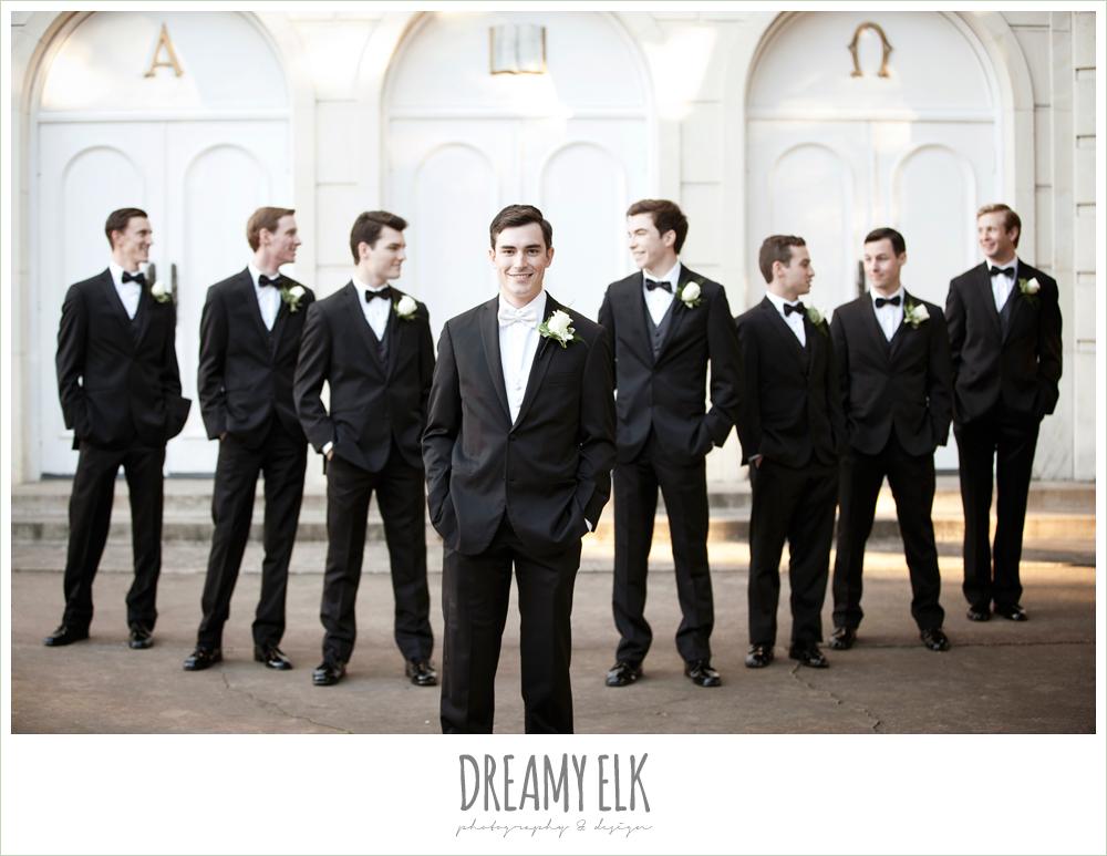 groom and groomsmen in classic tuxedos, sweetheart strapless wedding dress, white wedding bouquet, black bridesmaids dresses, winter wedding, austin wedding photographer, dreamy elk photography and design