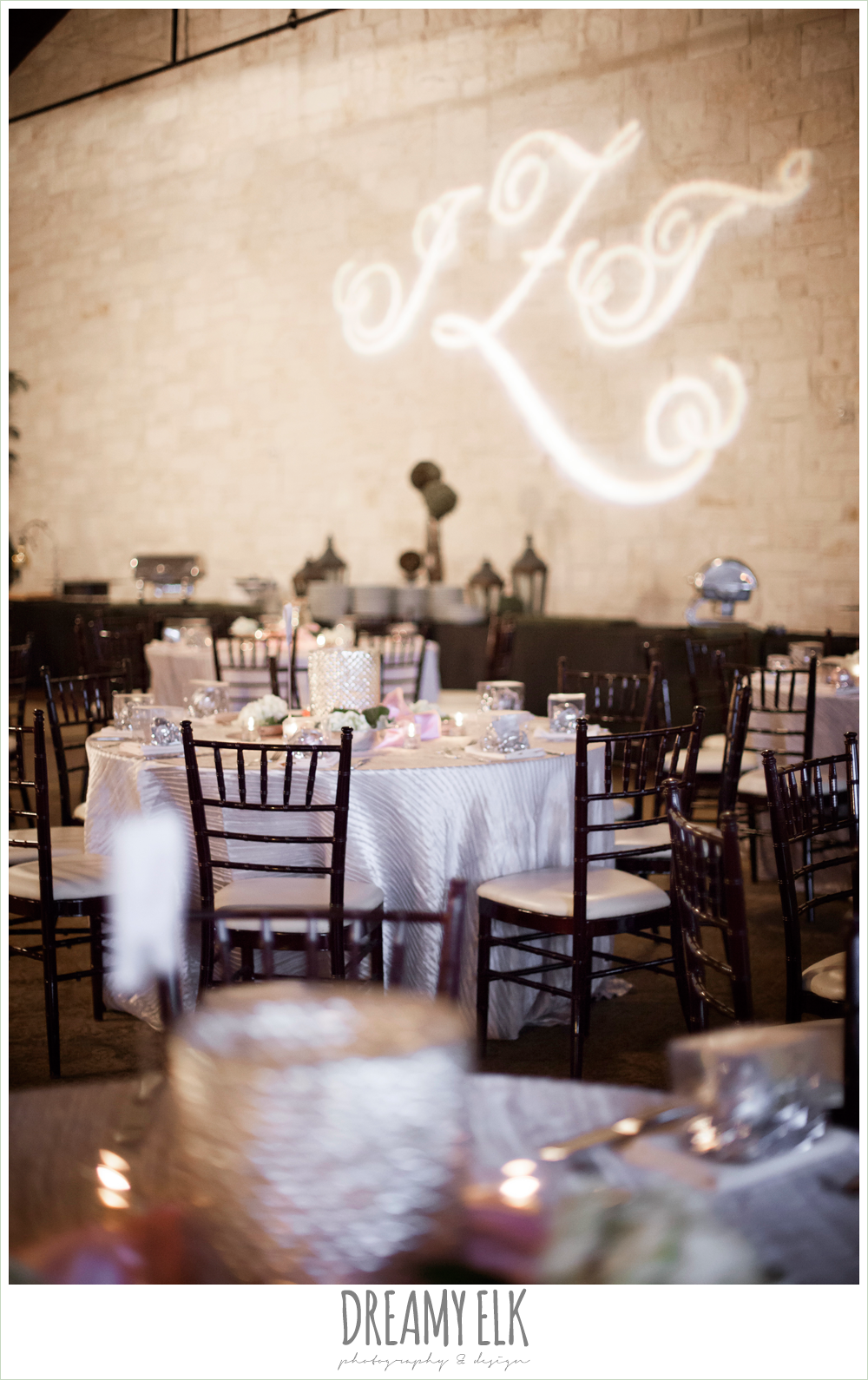 couples initials in lights on the wall, blush toned table linens, briscoe manor, houston winter wedding photo {dreamy elk photography and design}