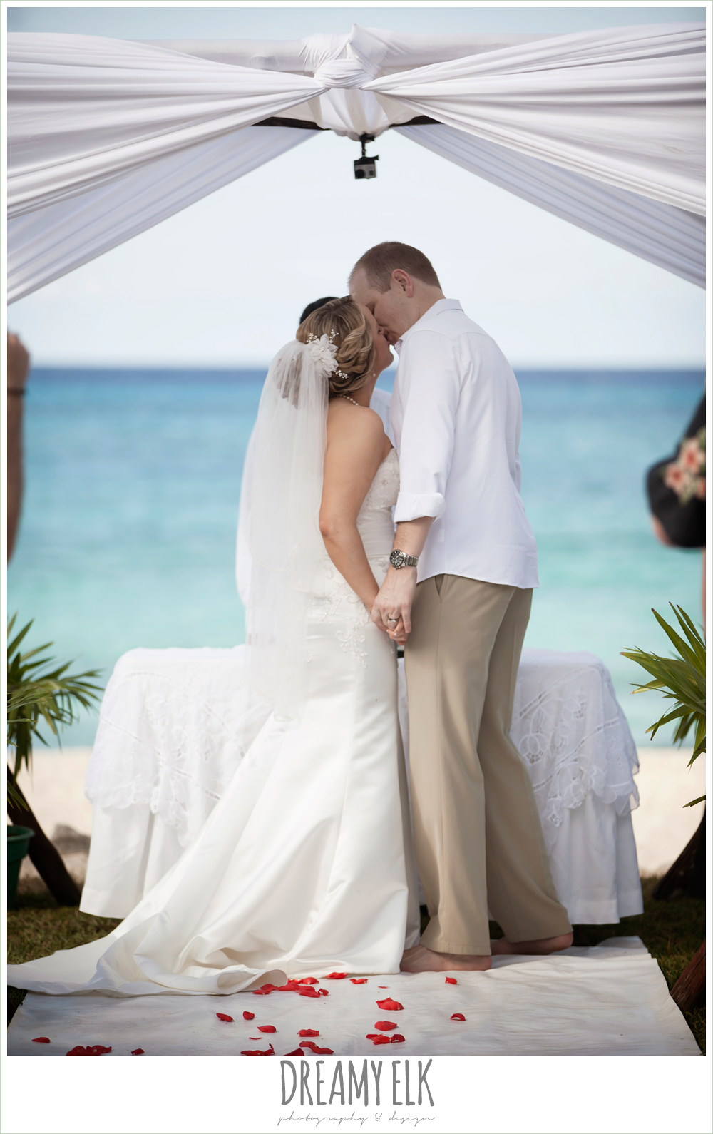 bride and groom first kiss, outdoor destination wedding, cozumel {dreamy elk photography and design} photo