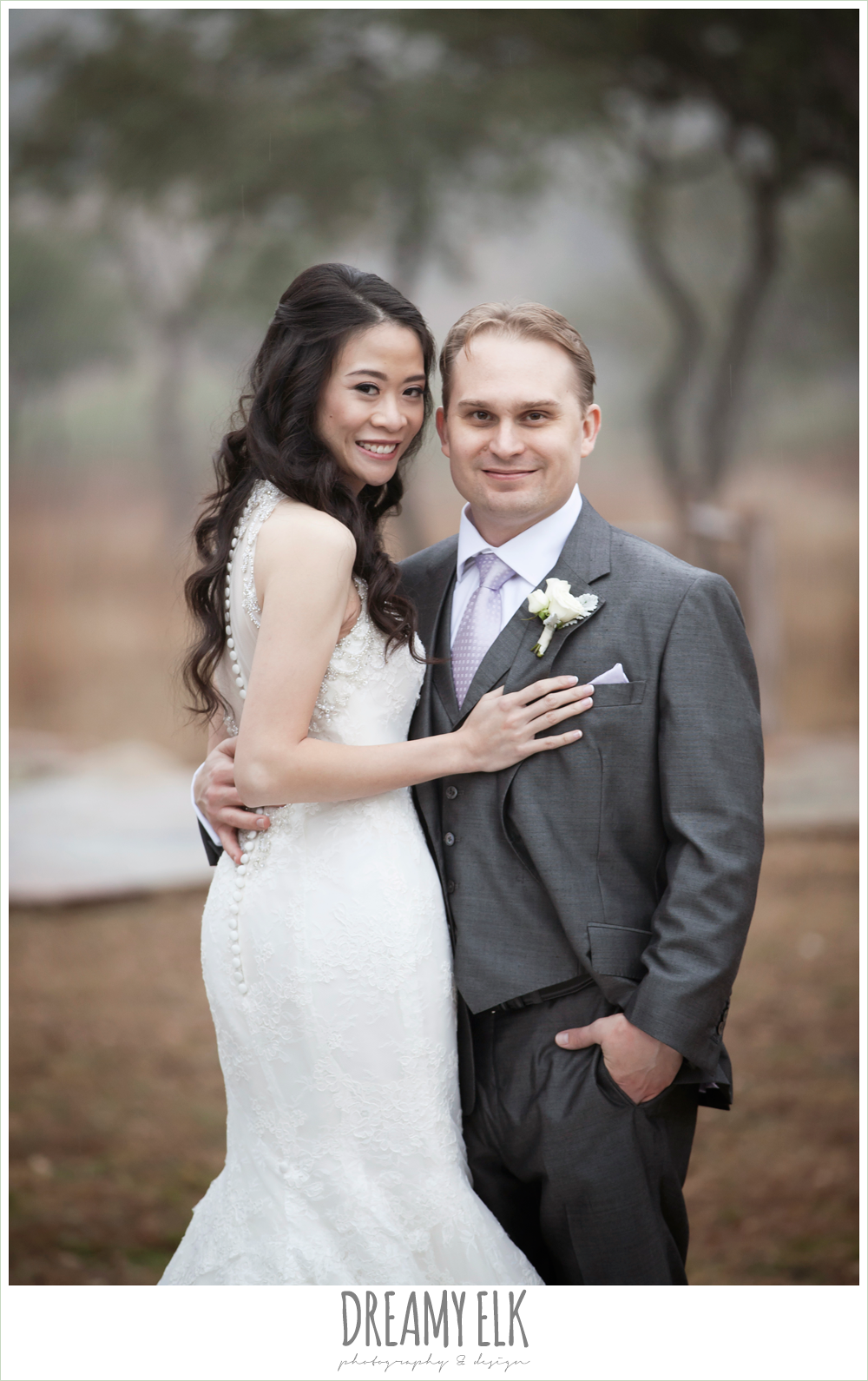 high necked trumpet wedding dress, illusion back wedding dress, groom in gray suit and light purple tie, foggy wedding day {dreamy elk photography and design}