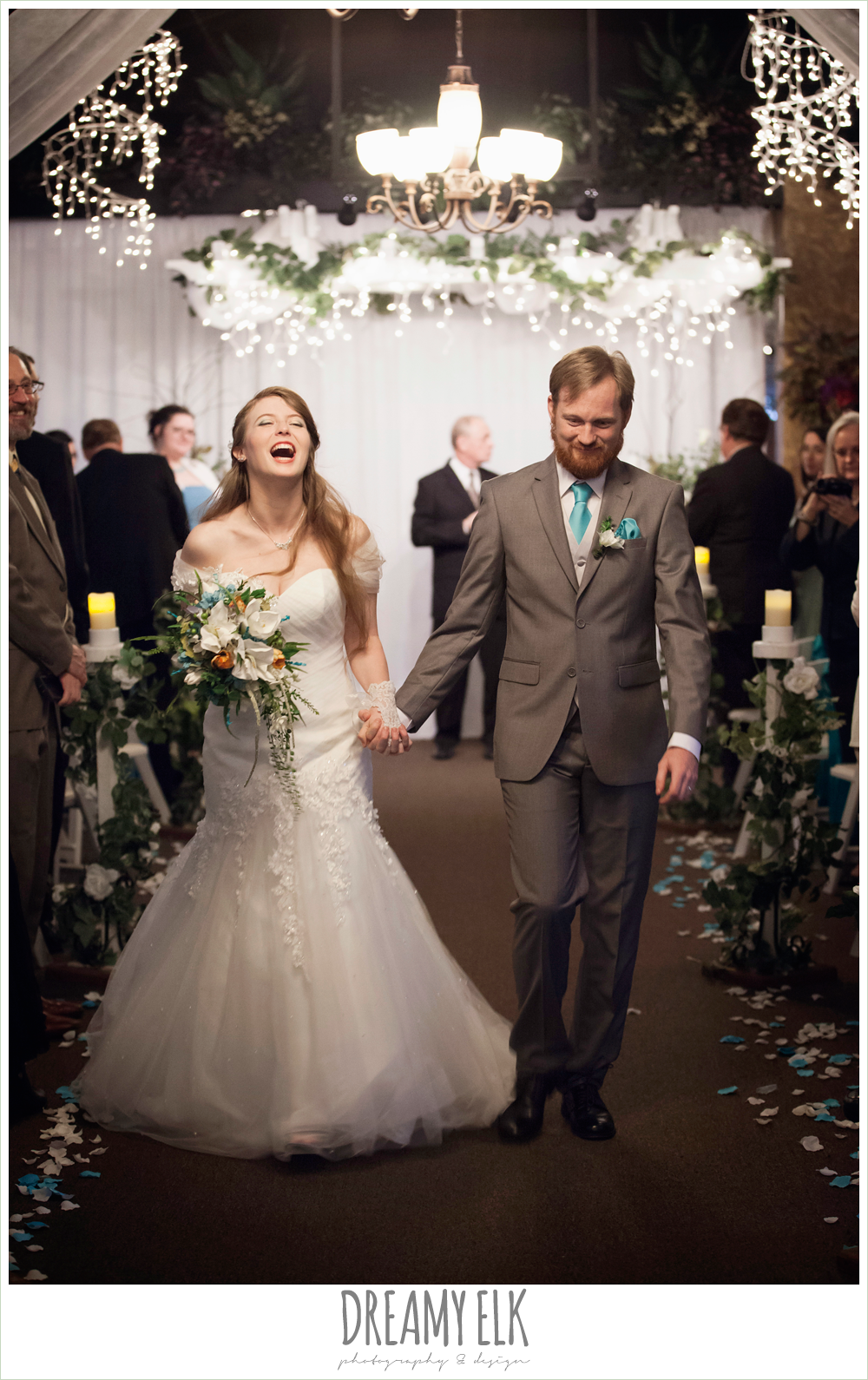 bride and groom walking down the aisle, indoor wedding ceremony, off the shoulder mermaid wedding dress, groom in gray suit, le jardin winter wedding {dreamy elk photography and design}