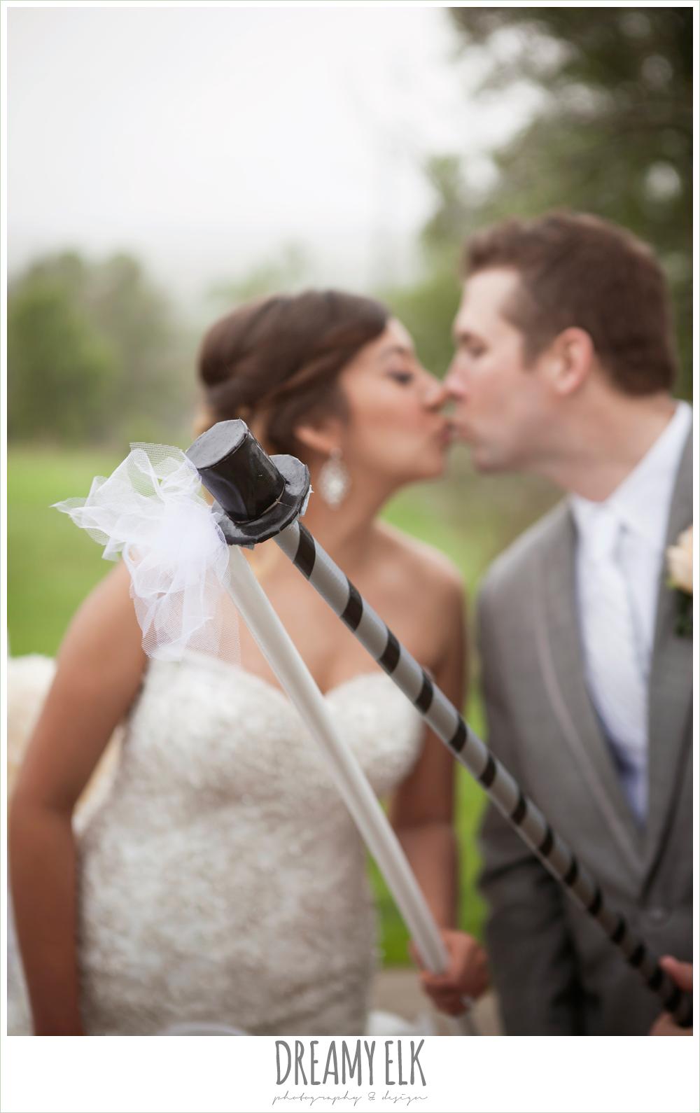pinatas at wedding reception, bride and groom kissing, austin spring wedding {dreamy elk photography and design}
