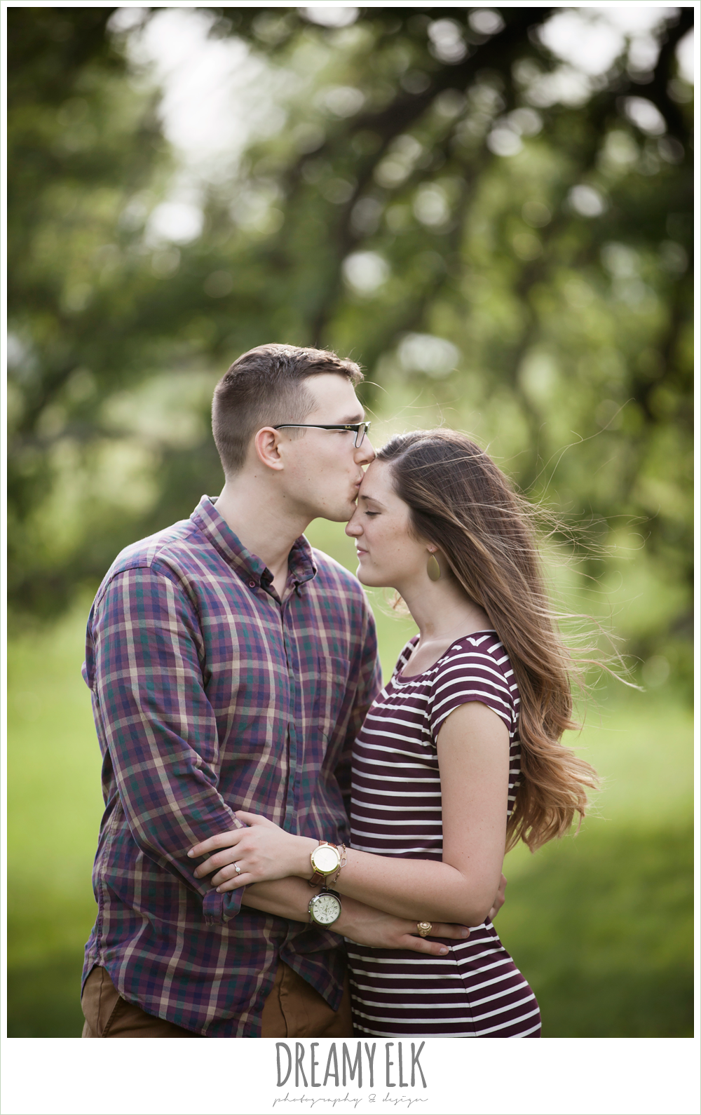 guy kissing girl on forehead, woodsy engagement photo, research park, college station, texas {dreamy elk photography and design}