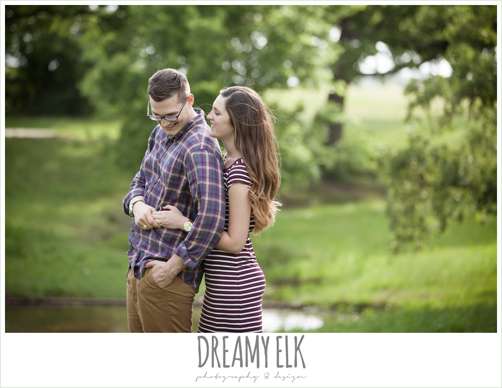 girl hugging guy from behind, woodsy engagement photo, research park, college station, texas {dreamy elk photography and design}