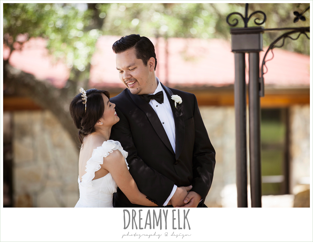 bride and groom seeing each other before the wedding, first look, chiffon wedding dress with ruffle sleeve, la hacienda, dripping springs, texas {dreamy elk photography and design} photo