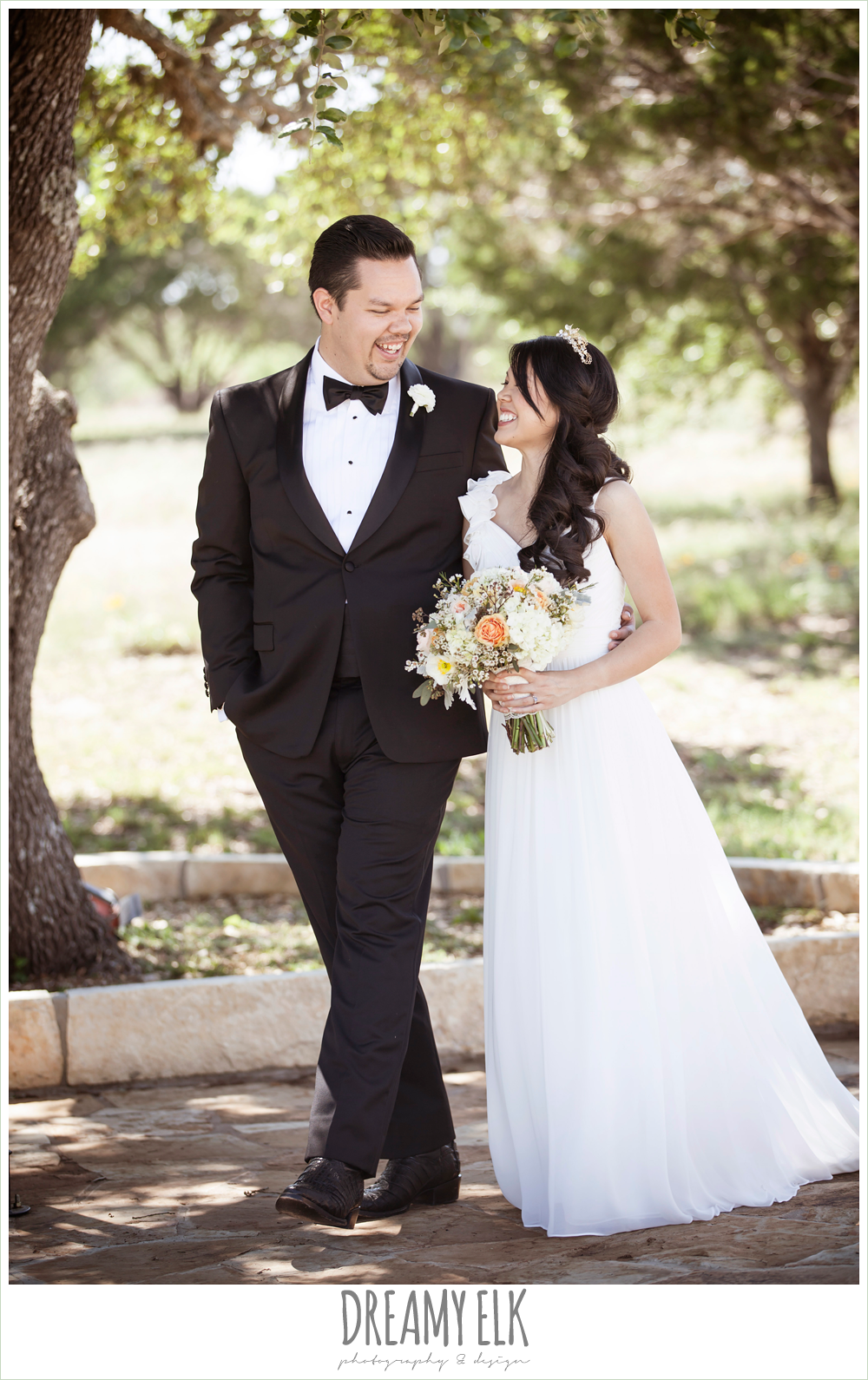 bride and groom walking, groom in tuxedo, chiffon wedding dress with ruffle sleeve, wedding hair side swept, pink orange and yellow bouquet, wild bunches florist, la hacienda, dripping springs, texas {dreamy elk photography and design} photo