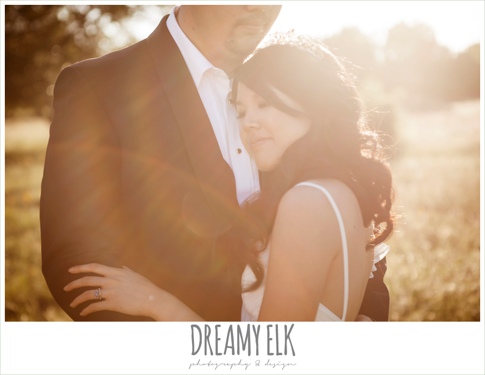 bride and groom sunset photo, wedding hair side swept, chiffon wedding dress with ruffle sleeve, groom in tux, la hacienda, dripping springs, texas {dreamy elk photography and design}