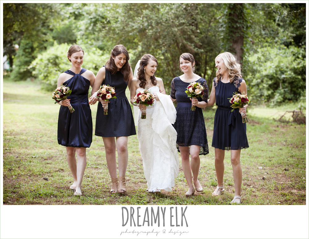 mix and matched navy bridesmaids dresses, peach and red wedding bouquets, bride and bridesmaids laughing and walking, pine lake ranch, photo {dreamy elk photography and design}