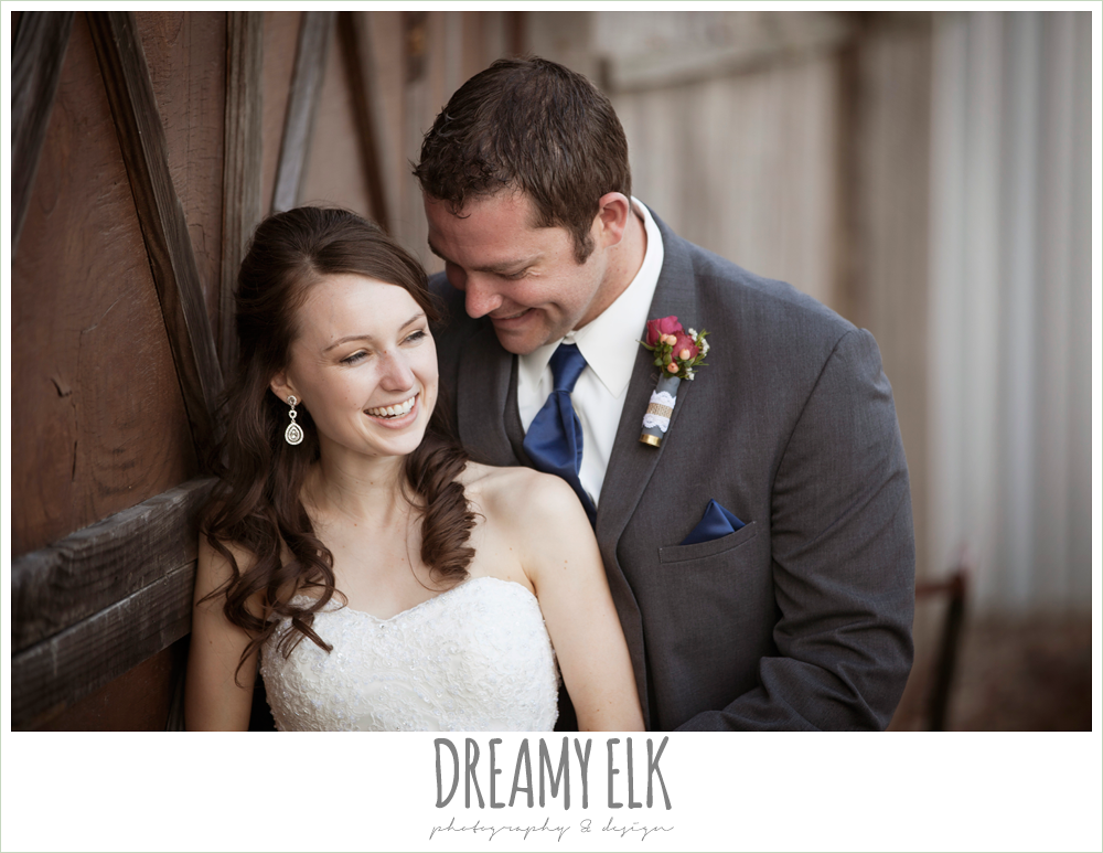 bride and groom laughing, strapless lace wedding dress with belt, gray suit and navy tie, pine lake ranch, rustic wedding photo {dreamy elk photography and design}