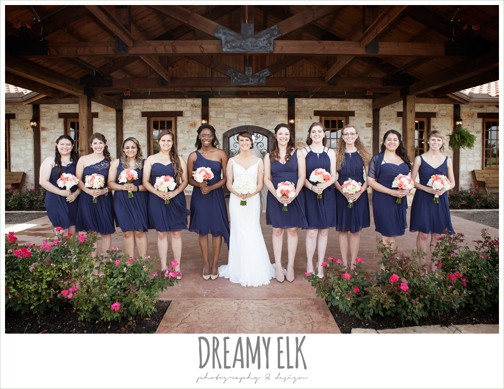 large bridal party, ten bridesmaids, navy mix matched bridesmaids dresses, pink and white bouquet, outdoor bridal portrait on porch, pearl draped sleeve lace wedding dress, white wedding bouquet, pecan springs, houston, texas, photo {dreamy elk photography and design}