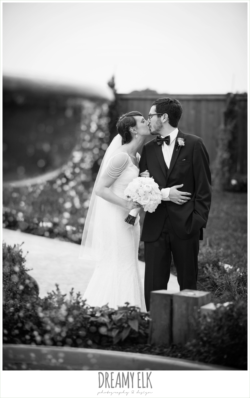 outdoor bride and groom portraits, bride and groom kissing, pecan springs, houston, texas, photo {dreamy elk photography and design}
