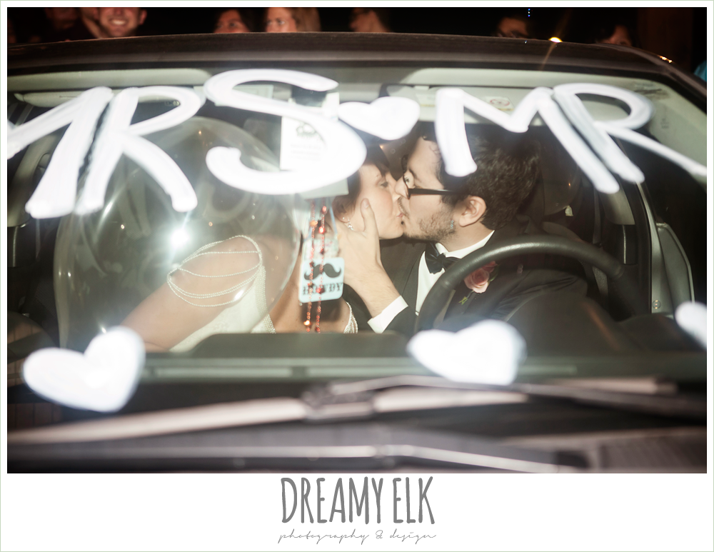 bride and groom kissing in getaway vehicle, mr and mrs., pecan springs, houston, texas photo {dreamy elk photography and design}