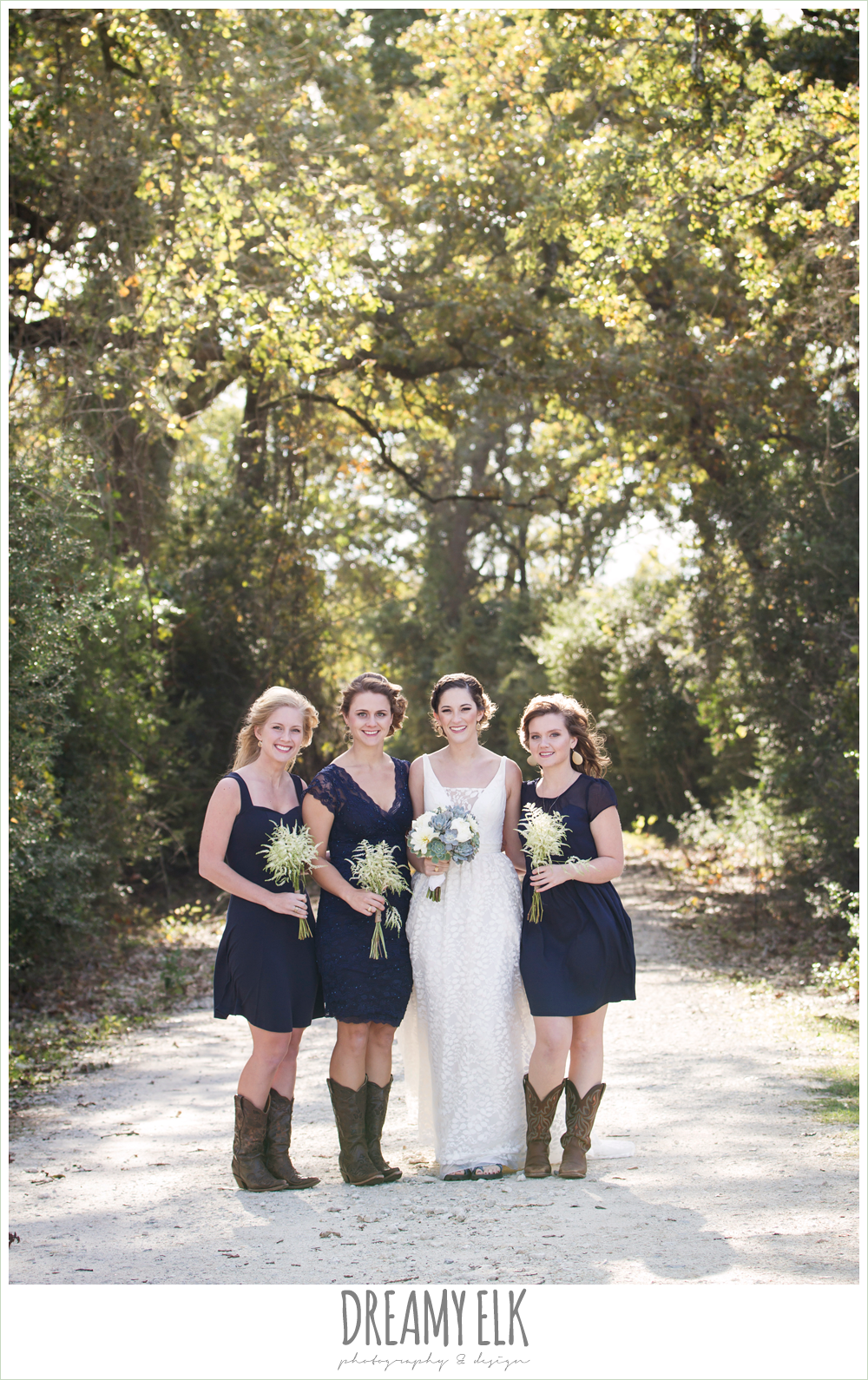 mix matched navy bridesmaids dresses, cowboy boots, rustic chic wedding photo, the amish barn at edge {dreamy elk photography and design}