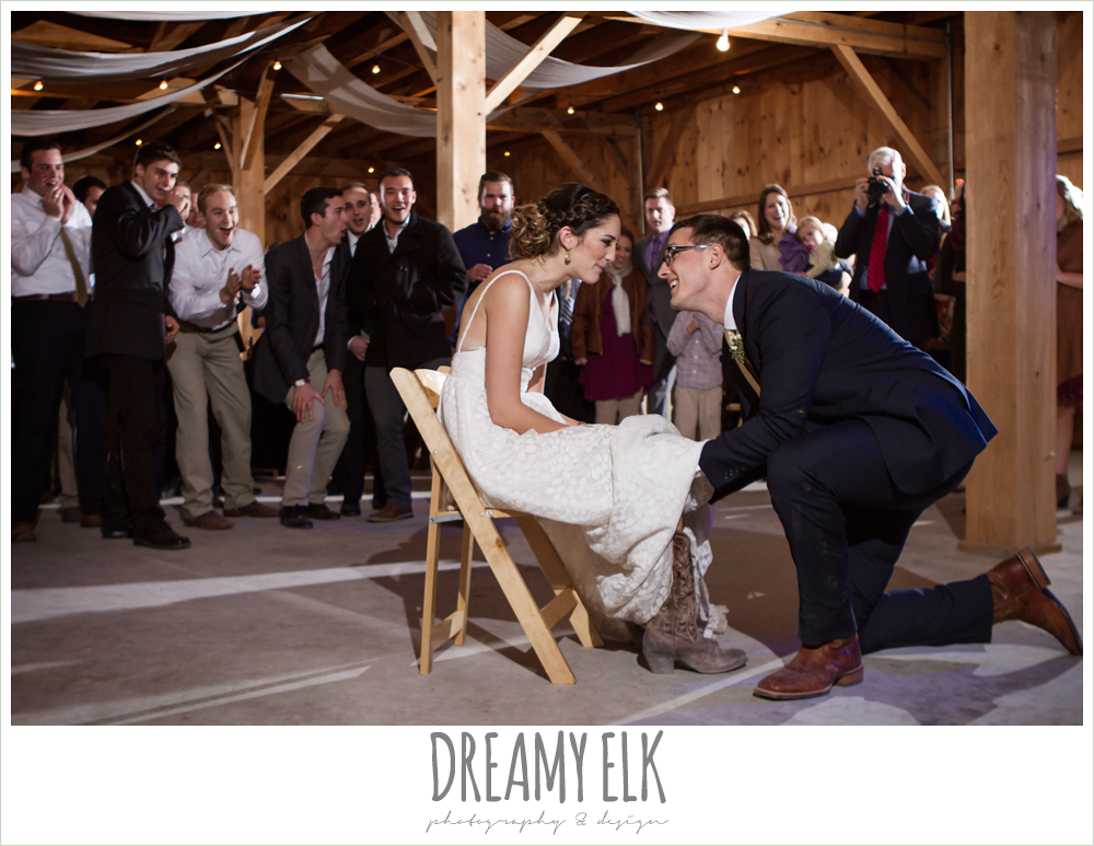 groom getting garter off  of bride, bride in cowboy boots, barn wedding reception, fall rustic chic wedding photo, the amish barn at edge {dreamy elk photography and design}