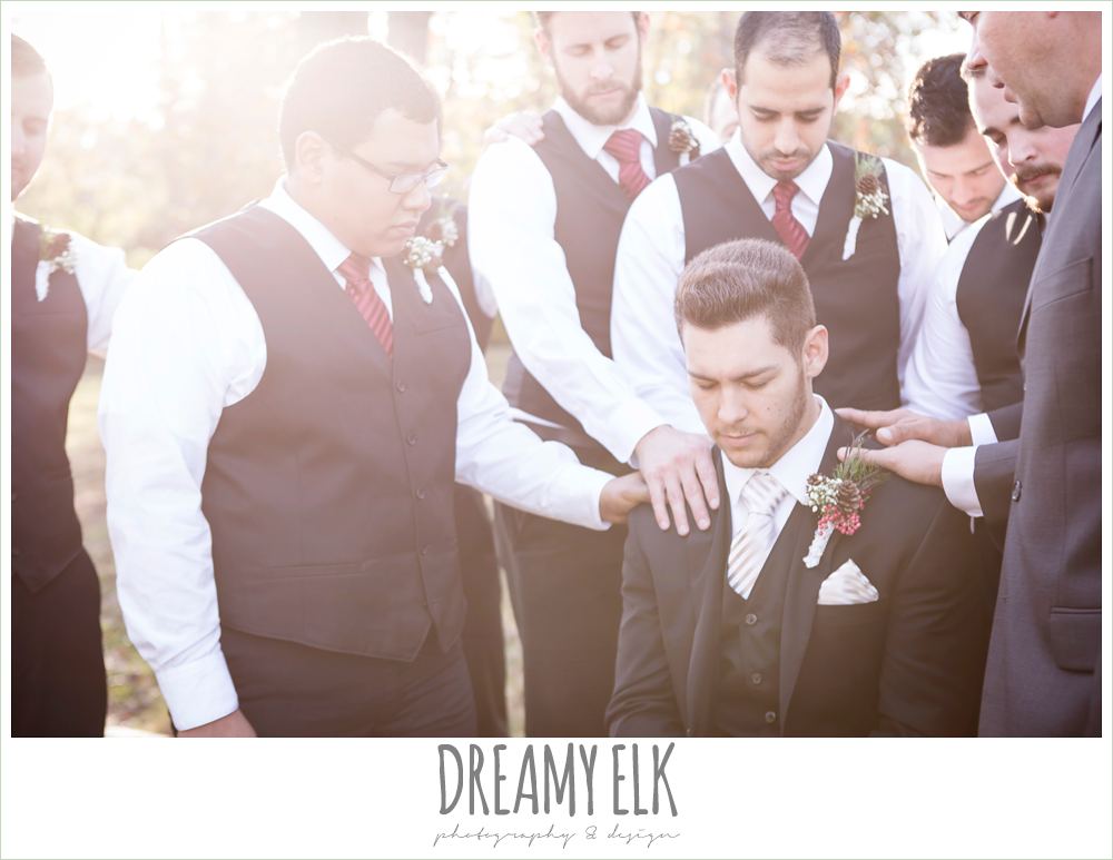 groomsmen praying over groom, winter december church wedding photo {dreamy elk photography and design}