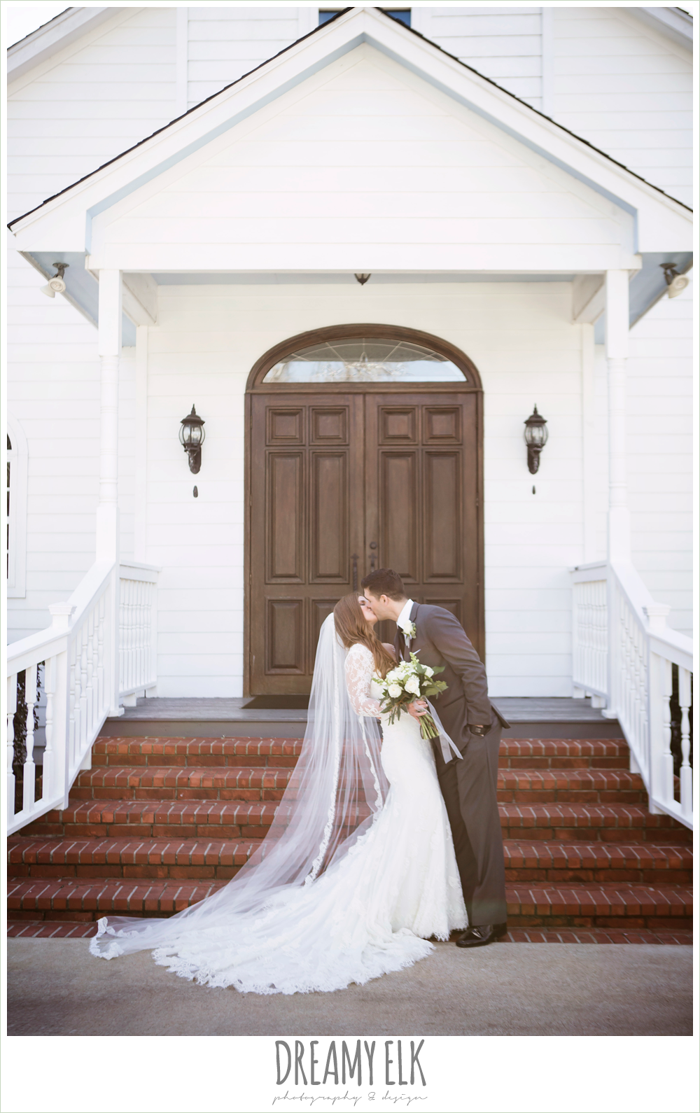 bride and groom kissing, long sleeve lace wedding dress, long lace veil, white chapel, morning winter january wedding, ashelynn manor {dreamy elk photography and design}