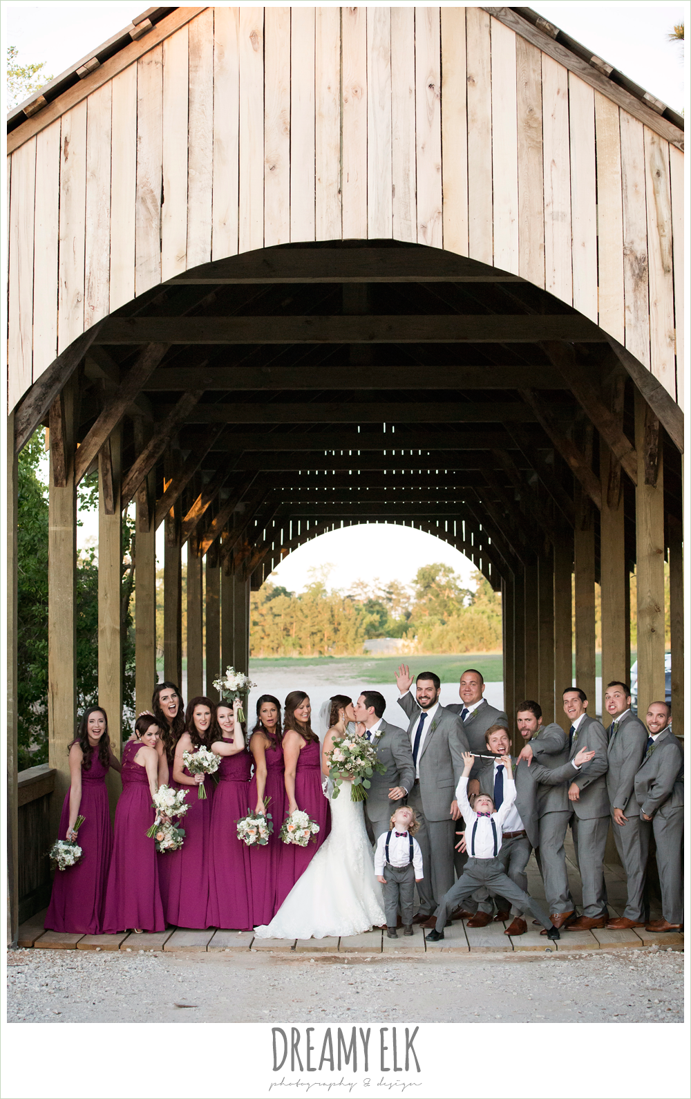 funny bridal party photo, bride and groom, sweetheart lace wedding dress, gray suit, mulberry bridesmaids dresses, rustic chic, spring wedding photo, big sky barn, montgomery, texas {dreamy elk photography and design}