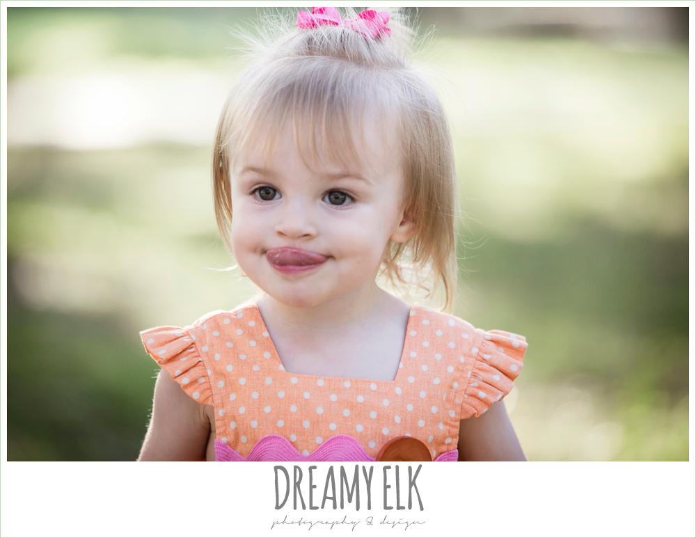 18 month old photo, photo of girl toddler outside sticking her tongue out
