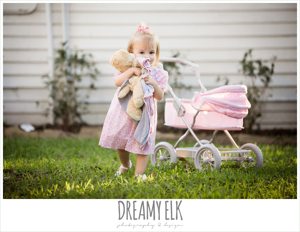 18 month old photo, photo of girl toddler outside with pottery barn doll pram