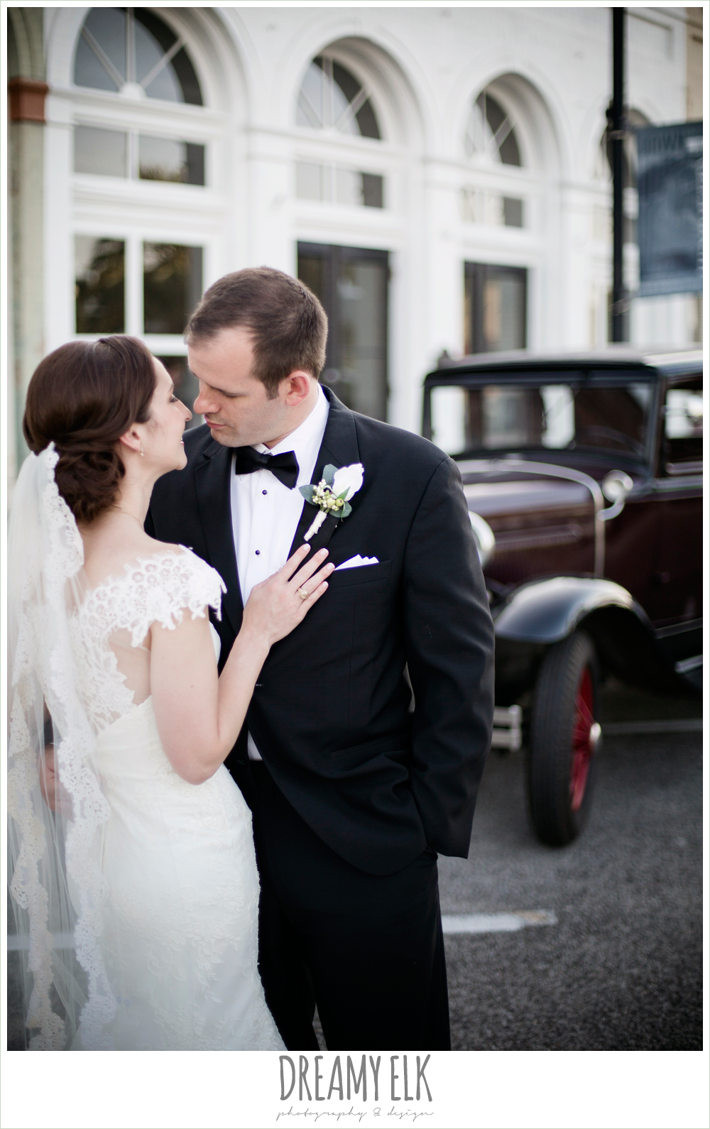 groom, classic tuxedo, white boutonniere, bride, lace wedding dress with lace sleeves, lace trimmed veil, bride and groom portrait, model t antique car, one eleven east, silver sequin wedding, fourth of july wedding photo {dreamy elk photography and design}