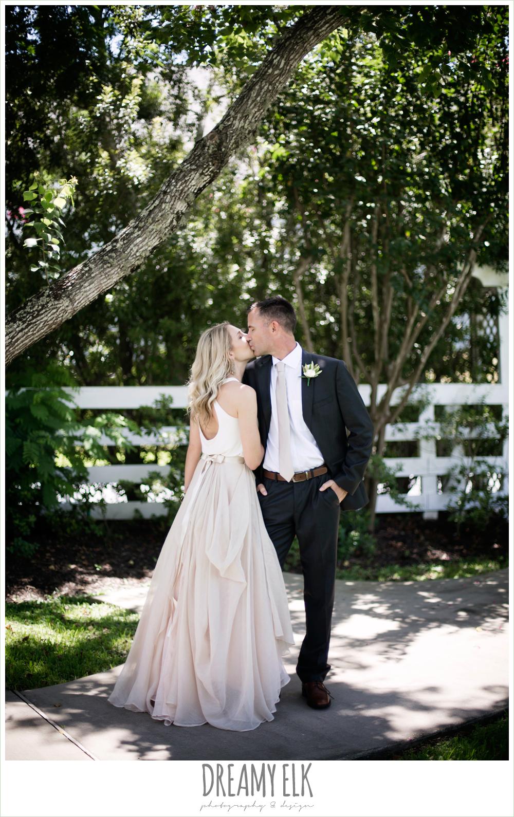 outdoor bride and groom photo, hugo boss groom's suit, southern protocol bridal boutique, carol hannah kensington halter and blush skirt,