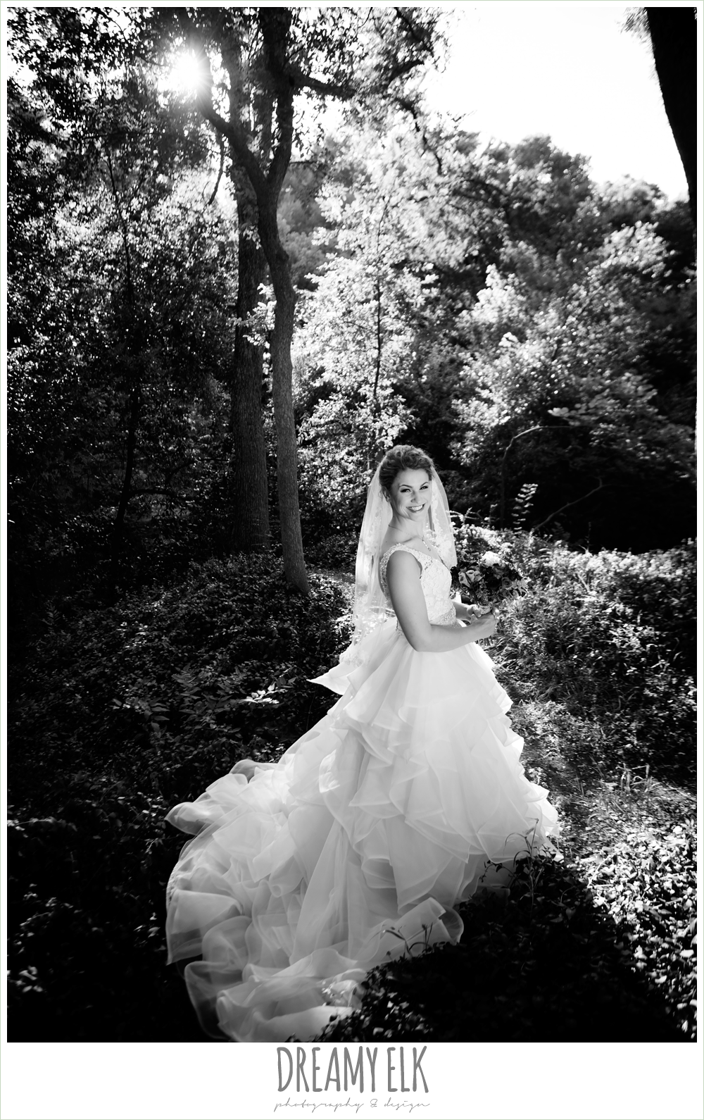 outdoor summer bridal photo in the woods, lace bodice wedding dress with ruffles, blush wedding dress, curly hair updo, lace wedding veil, pink wedding bouquet, dallas, texas, austin wedding photographer {dreamy elk photography and design}