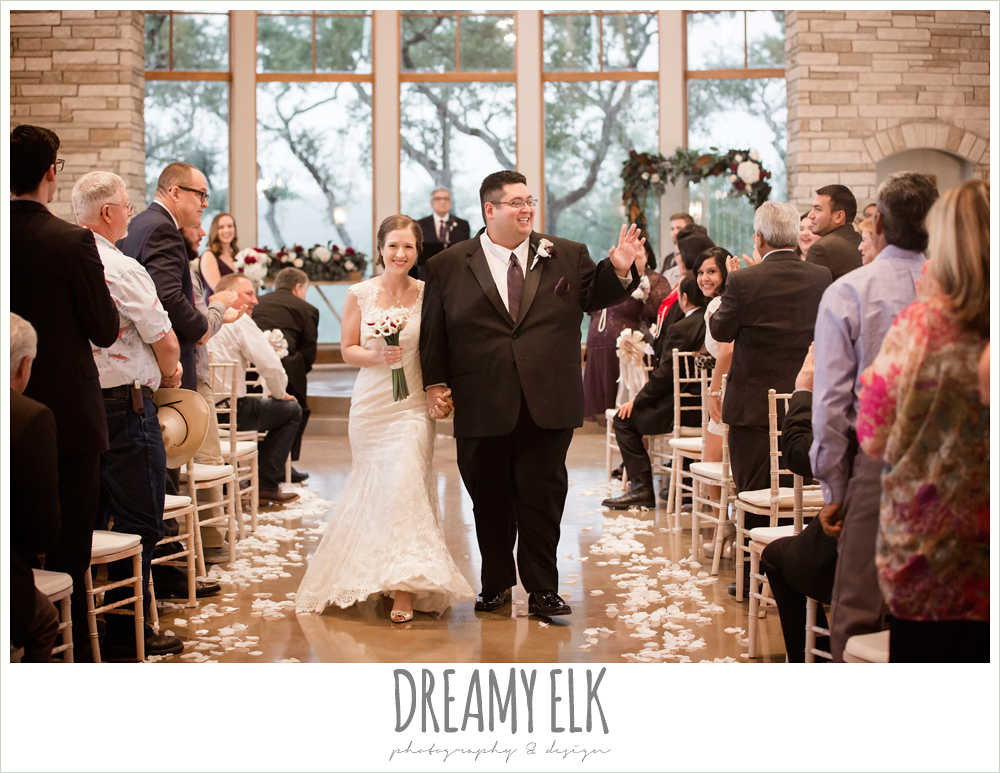 bride and groom walking down the aisle, indoor wedding ceremony, purple and gold wedding, fall rainy wedding, canyonwood ridge, dripping springs, texas, photo {dreamy elk photography and design}