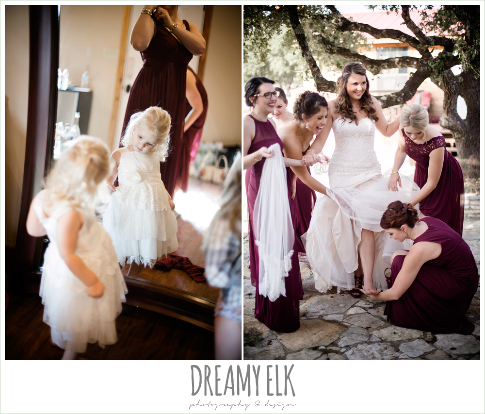 mix and match maroon long chiffon bridesmaid dresses, david's bridal, ventura's bridal fashions, sweetheart lace strapless fit and flare wedding dress, bride getting dressed, flower girl looking at herself in the mirror, maroon and gold fall wedding photo, la hacienda, dripping springs, texas {dreamy elk photography and design}