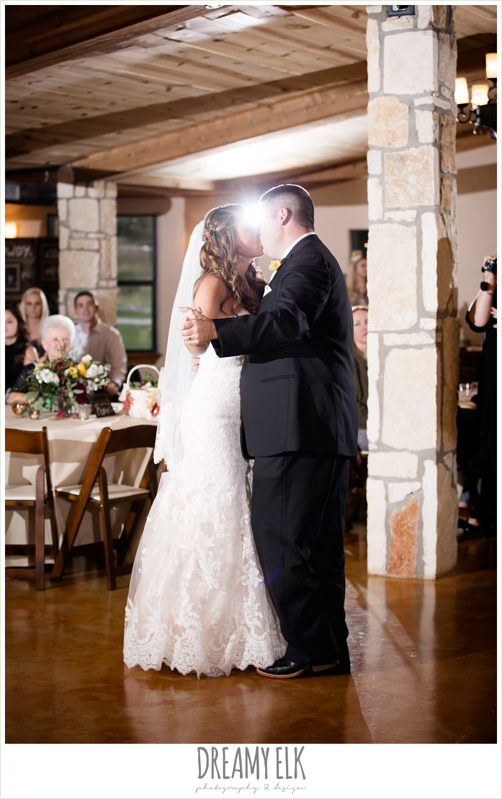 ventura's bridal fashions, sweetheart lace strapless fit and flare wedding dress, bride and groom first dance, indoor wedding reception, maroon and gold fall wedding photo, la hacienda, dripping springs, texas {dreamy elk photography and design}