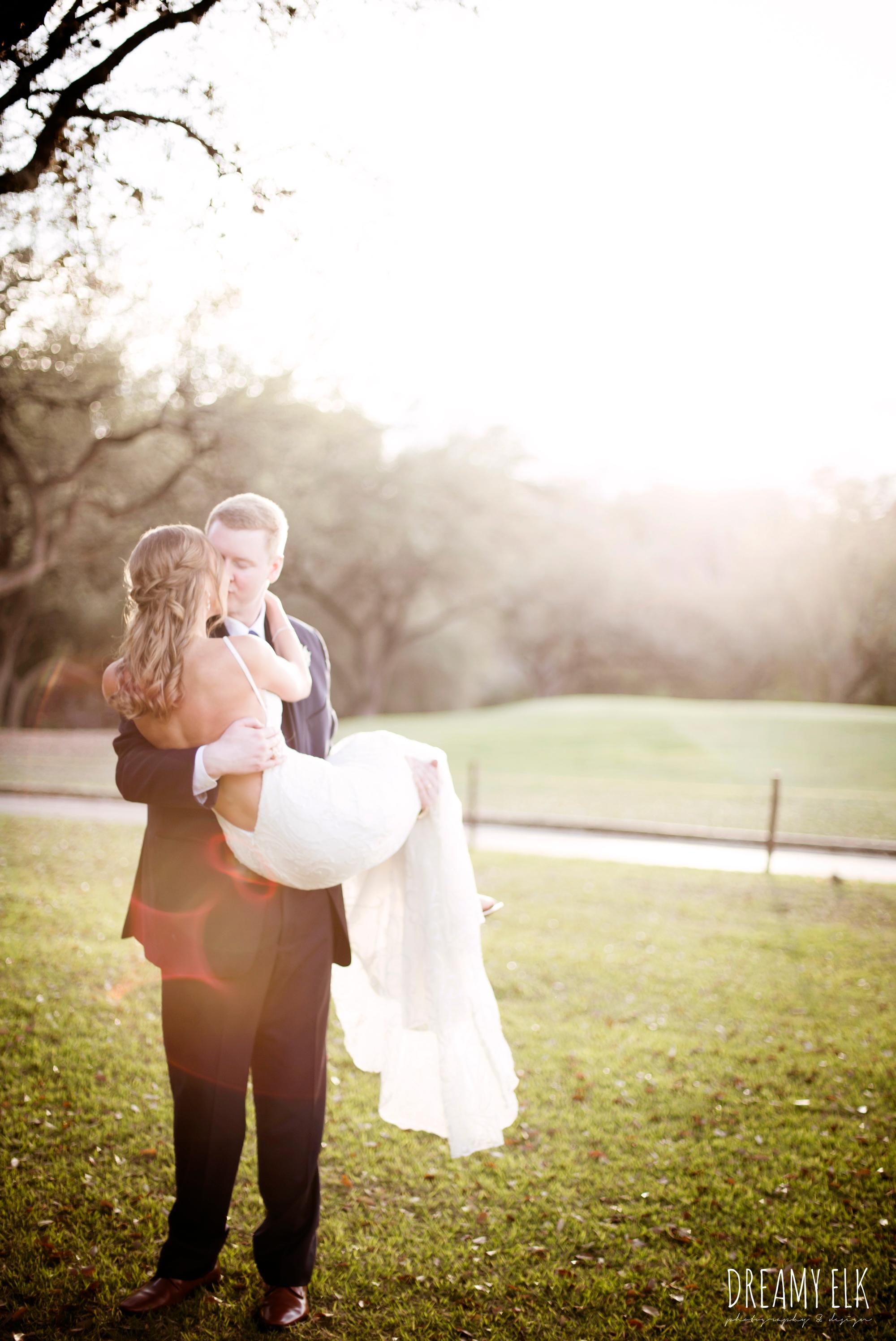 groom holding bride, sunset, romantic, bride and groom, navy suit, backless column sheath wedding dress, cloudy march wedding photo, canyon springs golf club wedding, san antonio, texas {dreamy elk photography and design}