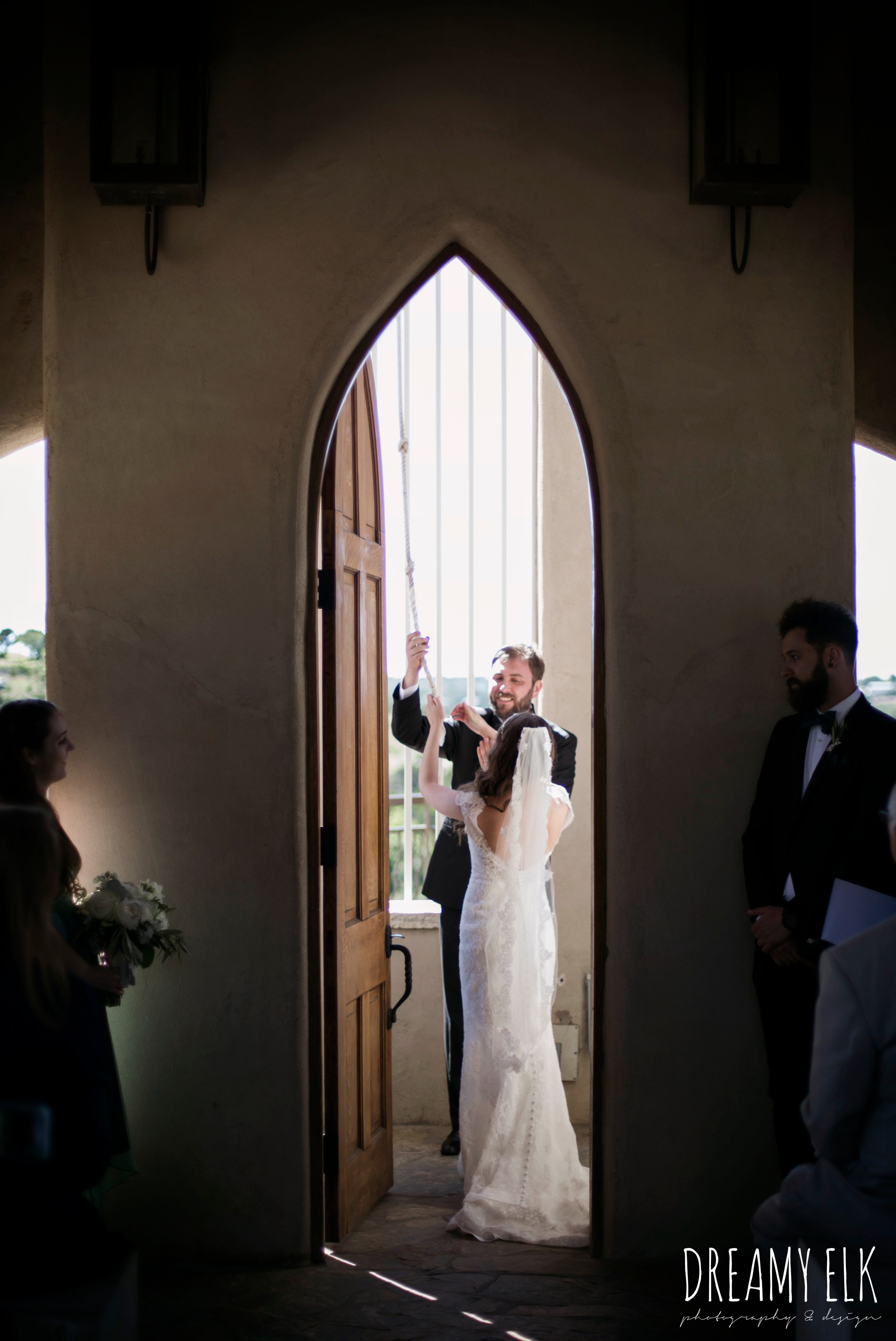 bride and groom ringing the bell, outdoor spring april wedding photo, chapel dulcinea ceremony, thurman's mansion, dripping springs, texas {dreamy elk photography and design}